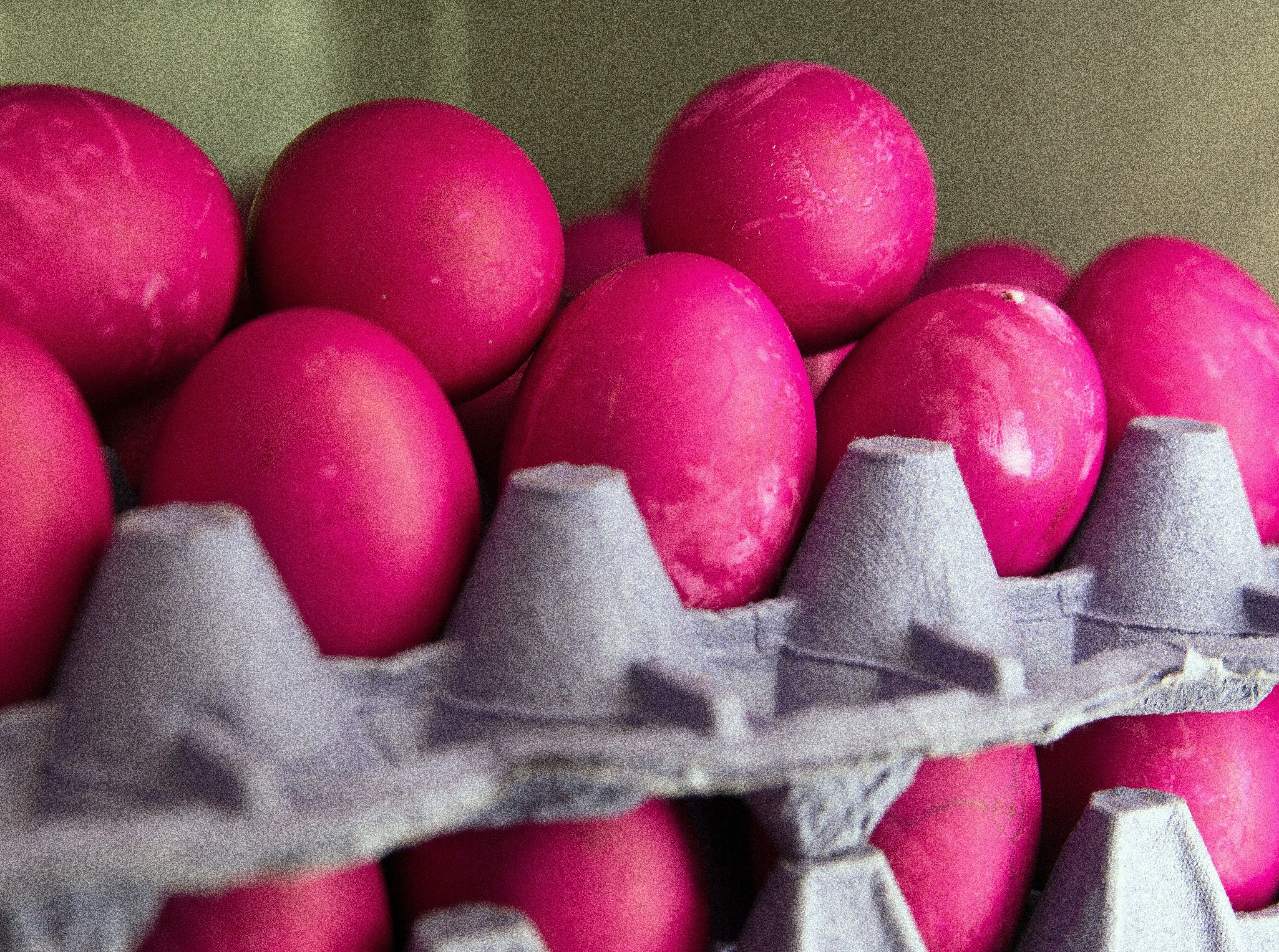 A stack of Easter eggs that have been dyed pink.