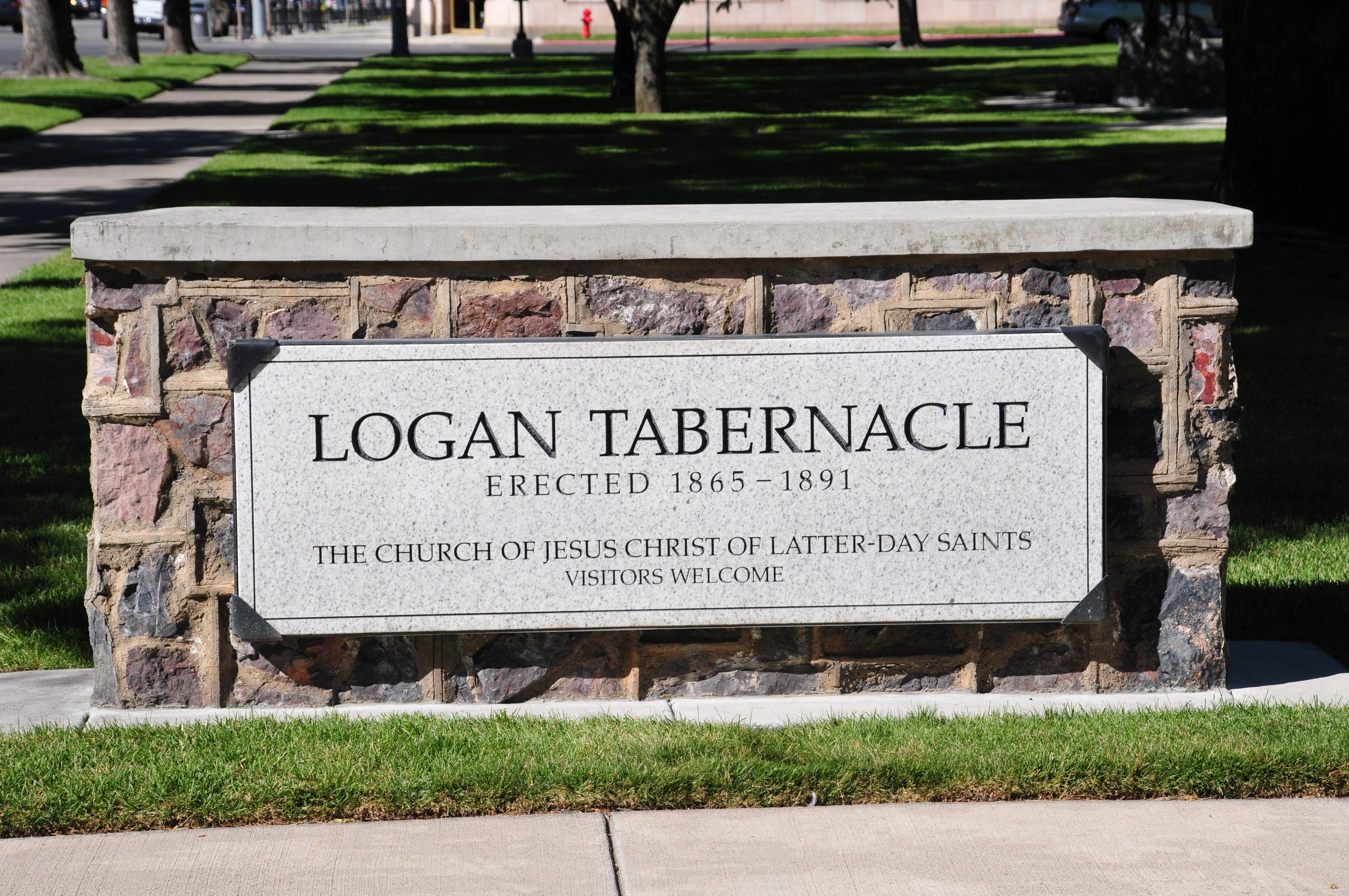 A sign surrounded by brick outside the Logan Tabernacle.