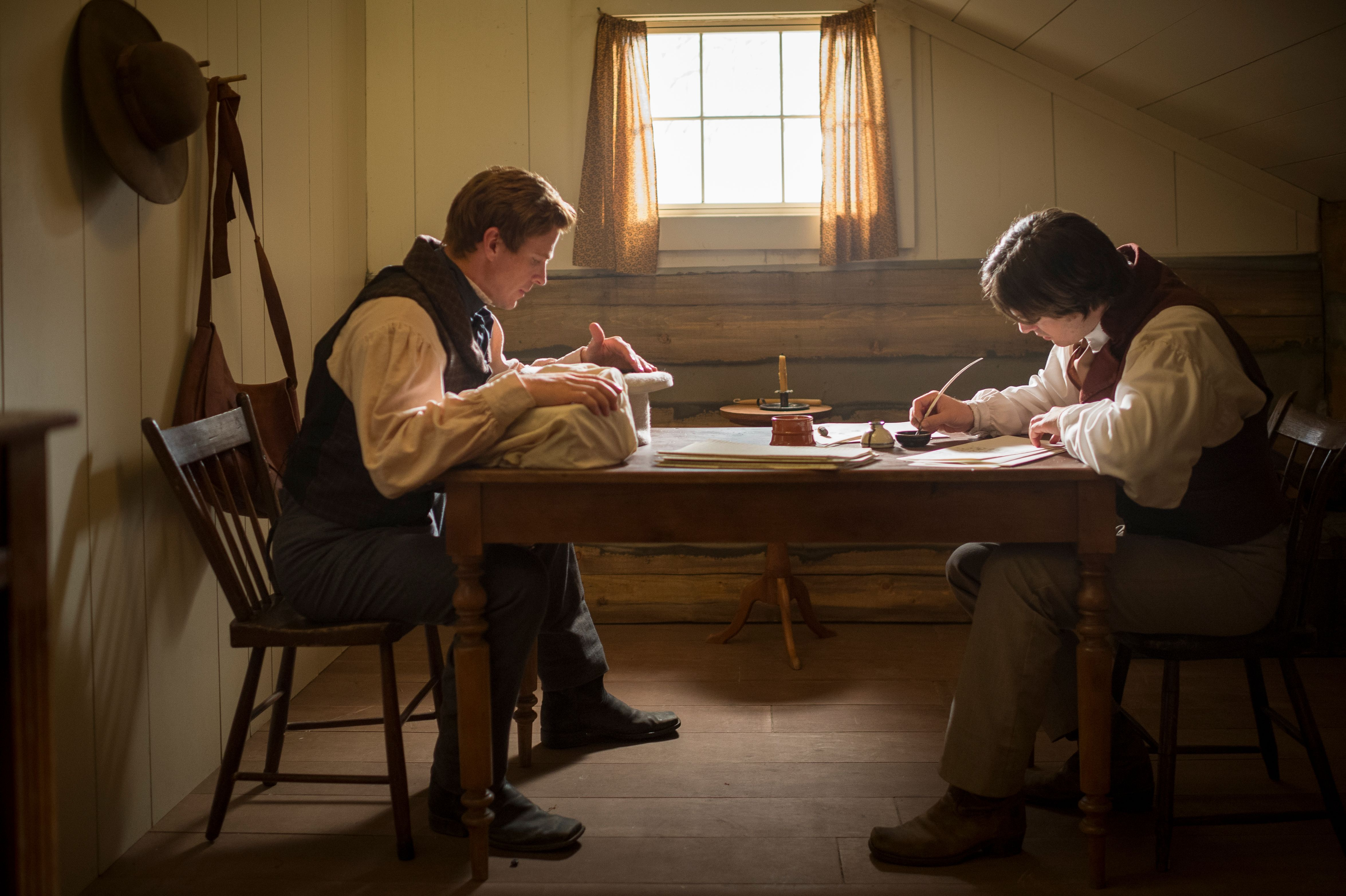 """An image from the video """"A Day for the Eternities"""" depicting Joseph Smith translating the Book of Mormon, dictating the text to his scribe, Oliver Cowdery."""