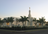 The Hermosillo Sonora Mexico Temple in the evening, surrounded by palm trees and a white fence.