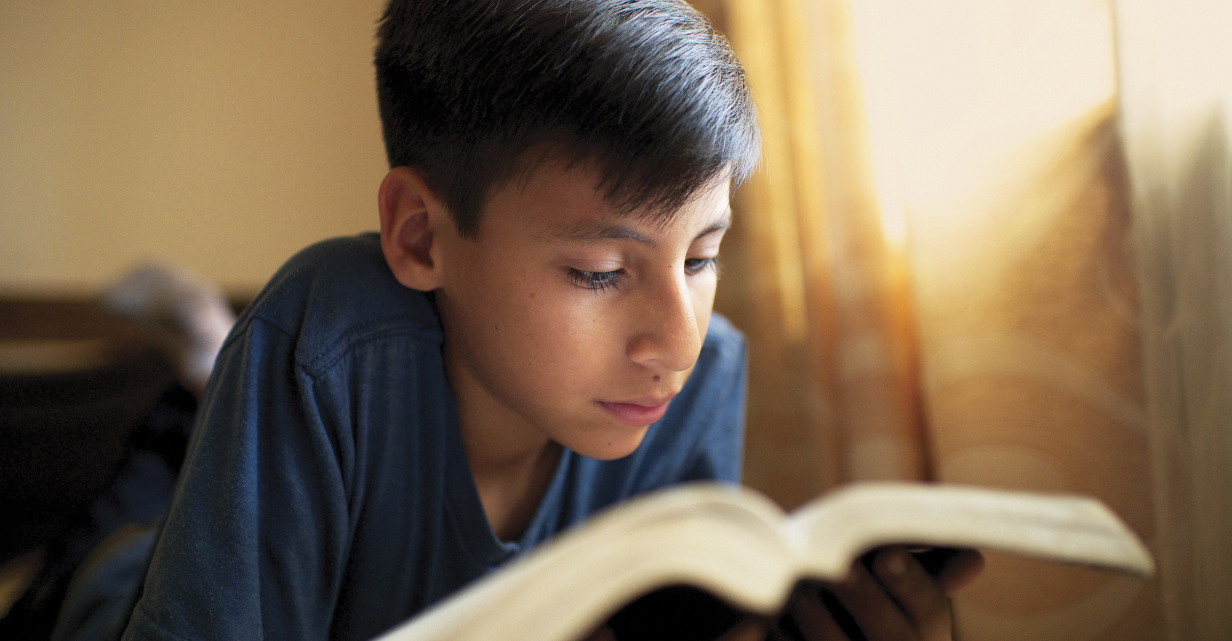 A Bolivian boy reads the scriptures.