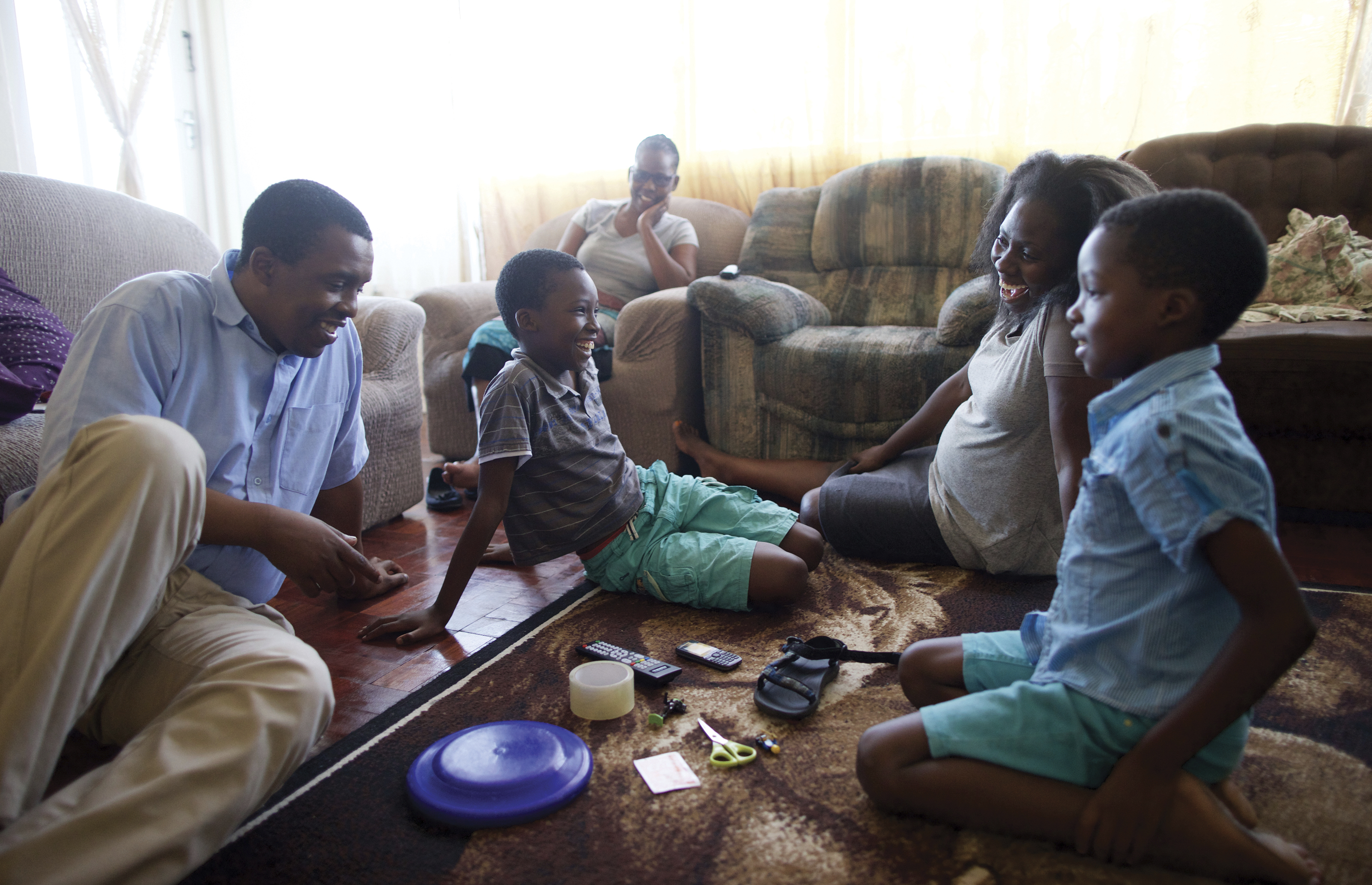 A family playing games during family home evening.