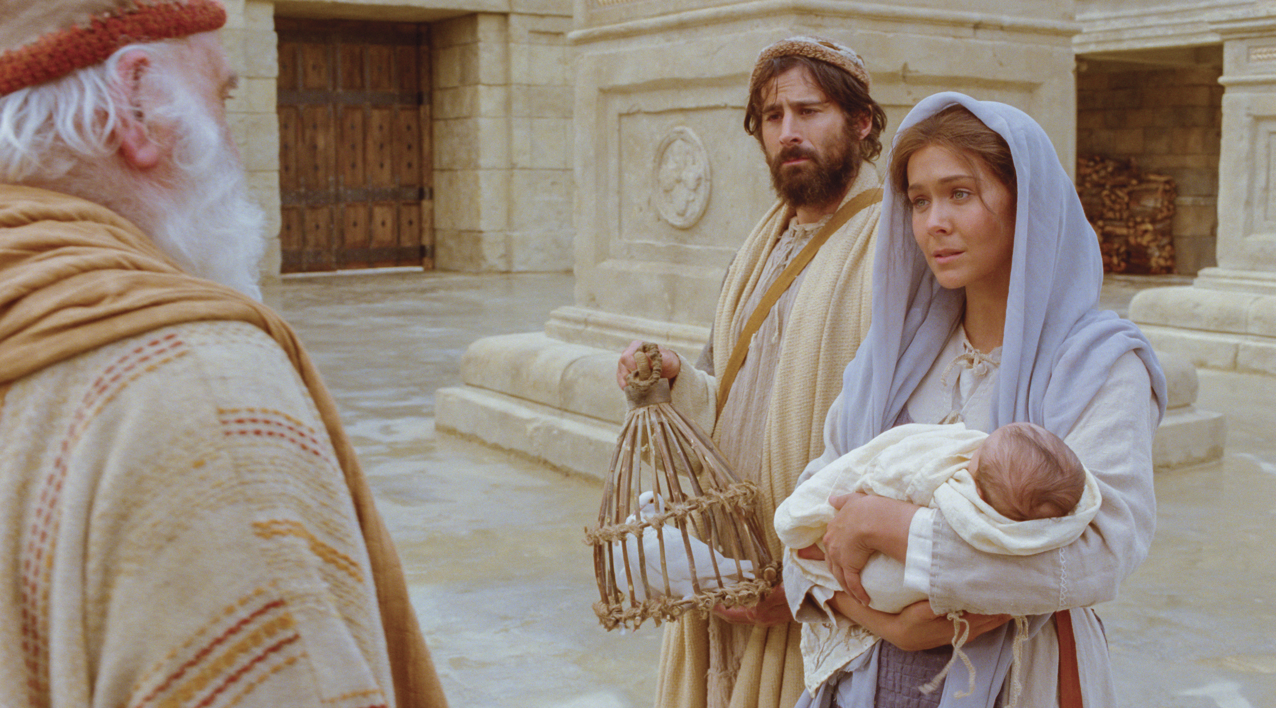 Mary, Joseph, and baby Jesus at the temple.