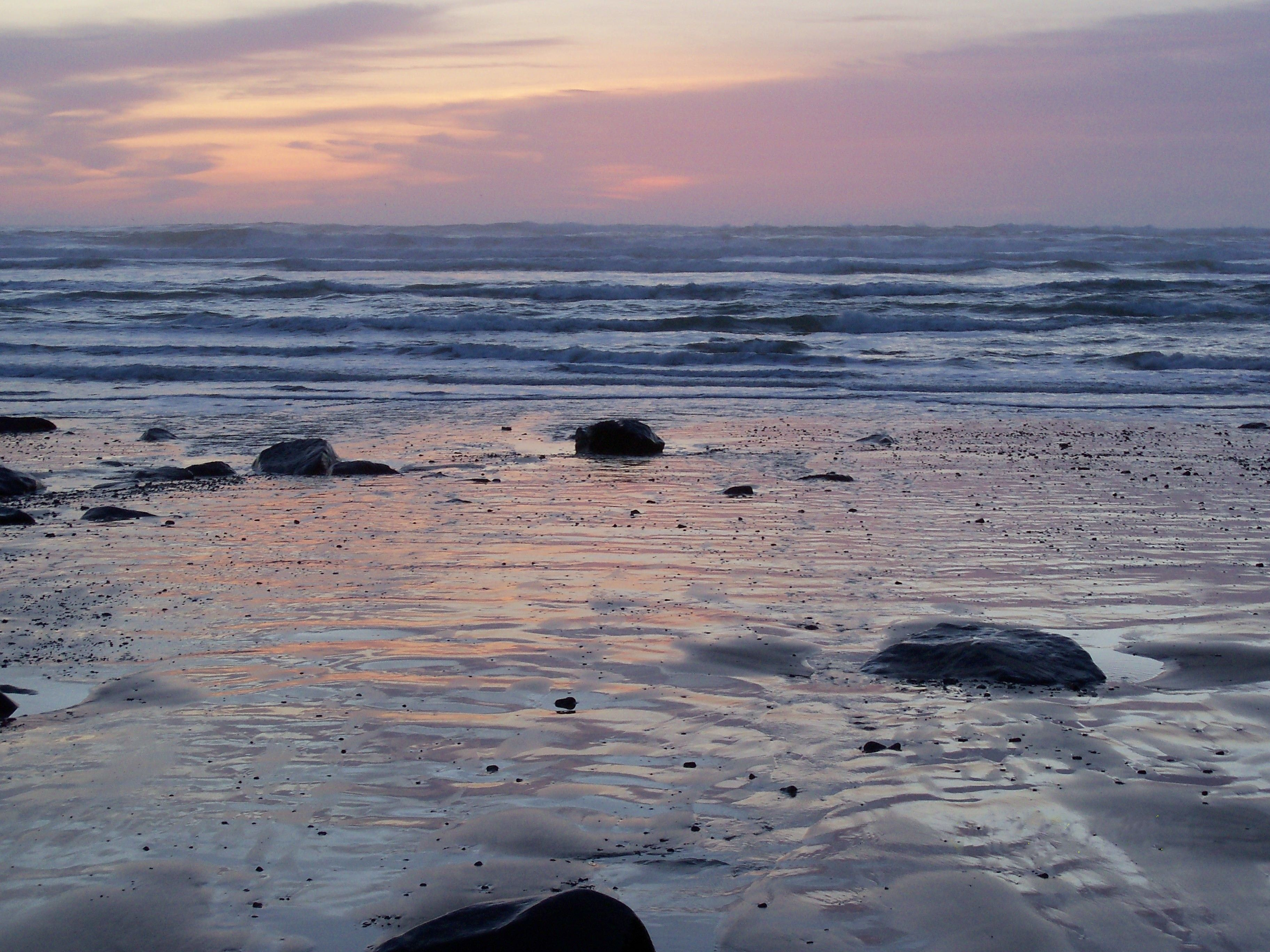 Rocks on the shore at sunset.