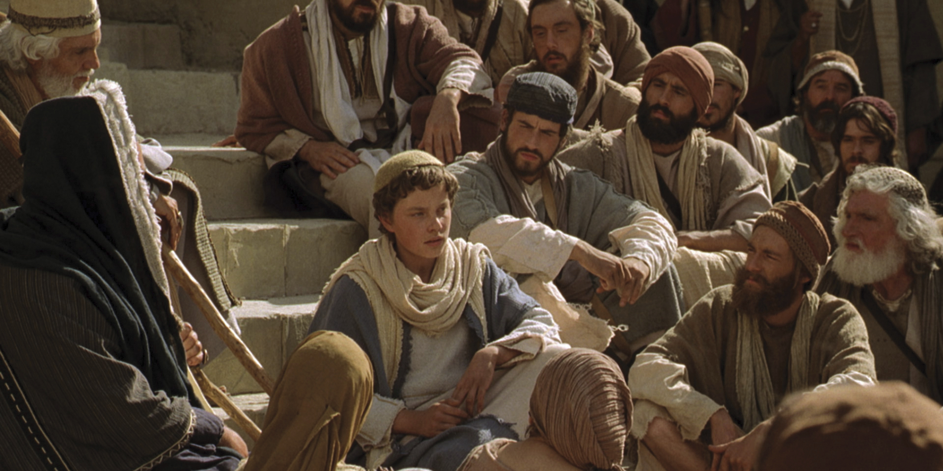Young Jesus teaching doctors in the temple.