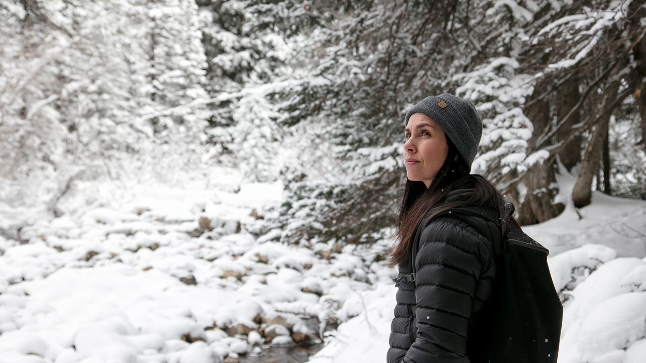 Juliana standing in a forest explains how the Book of Mormon helps her