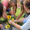 Utah: Young Women Sunflowers at Grave