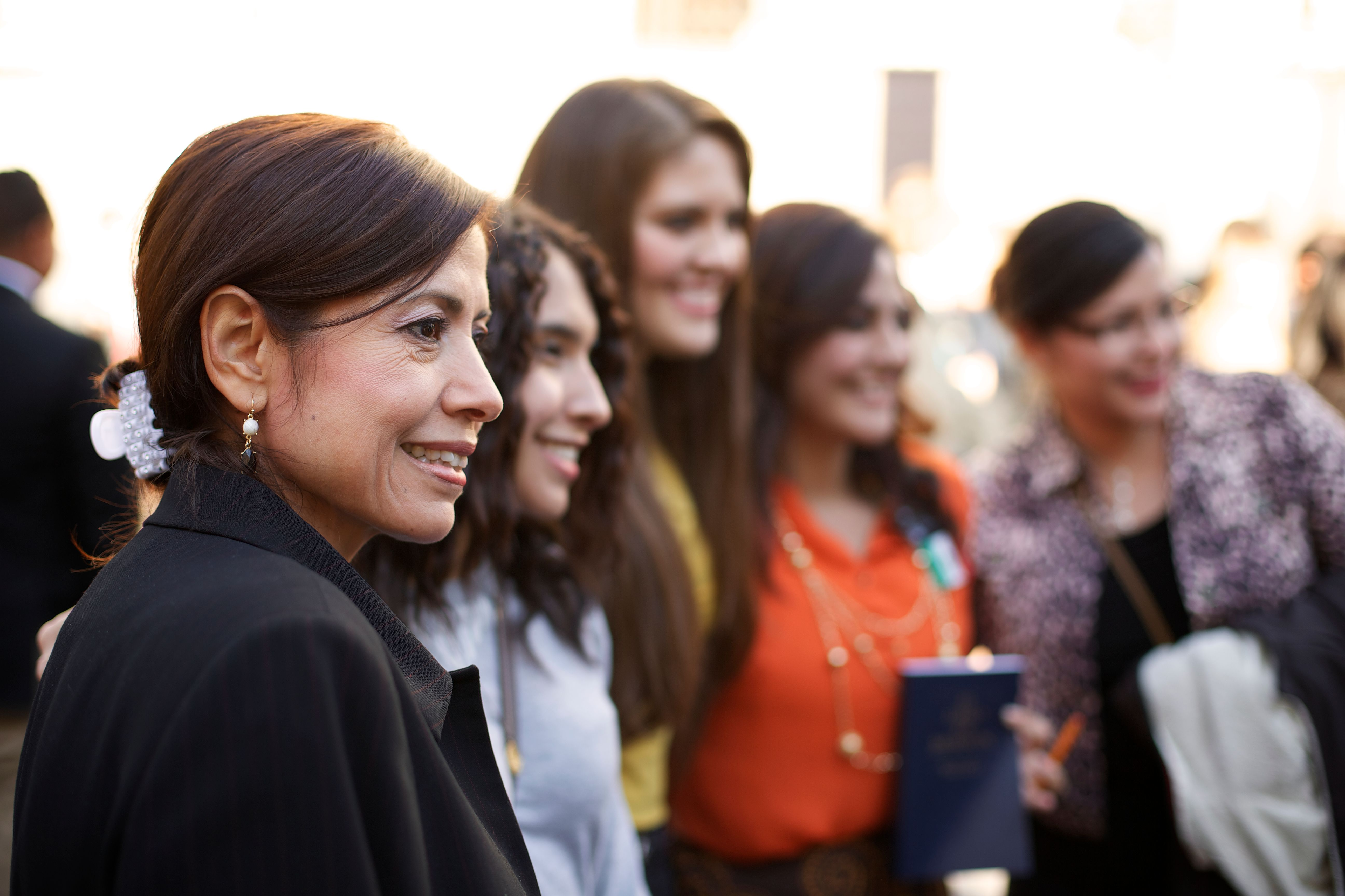 A woman standing in a group with other women outside the Conference Center.