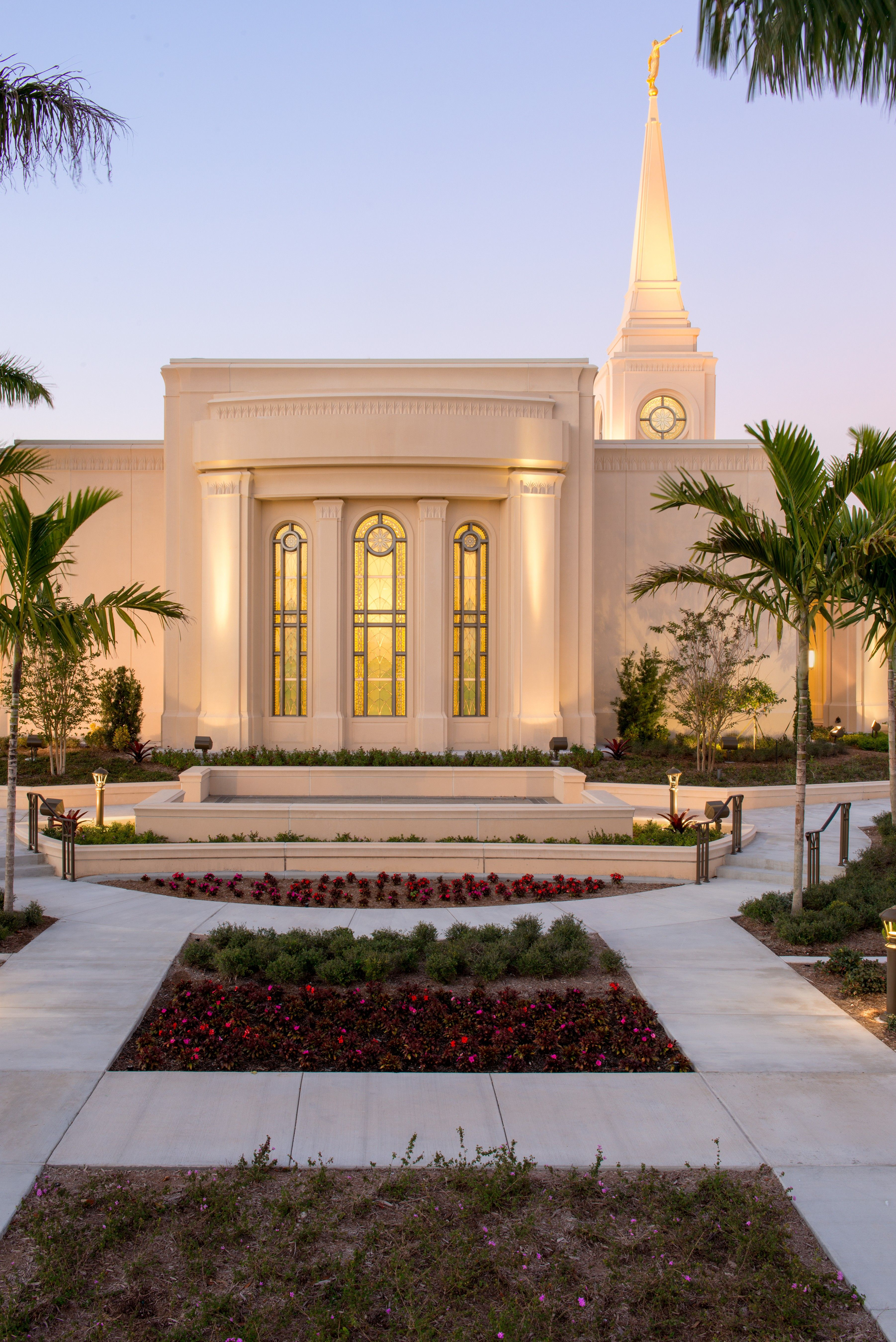 The windows of the Fort Lauderdale Florida Temple lit up at night.