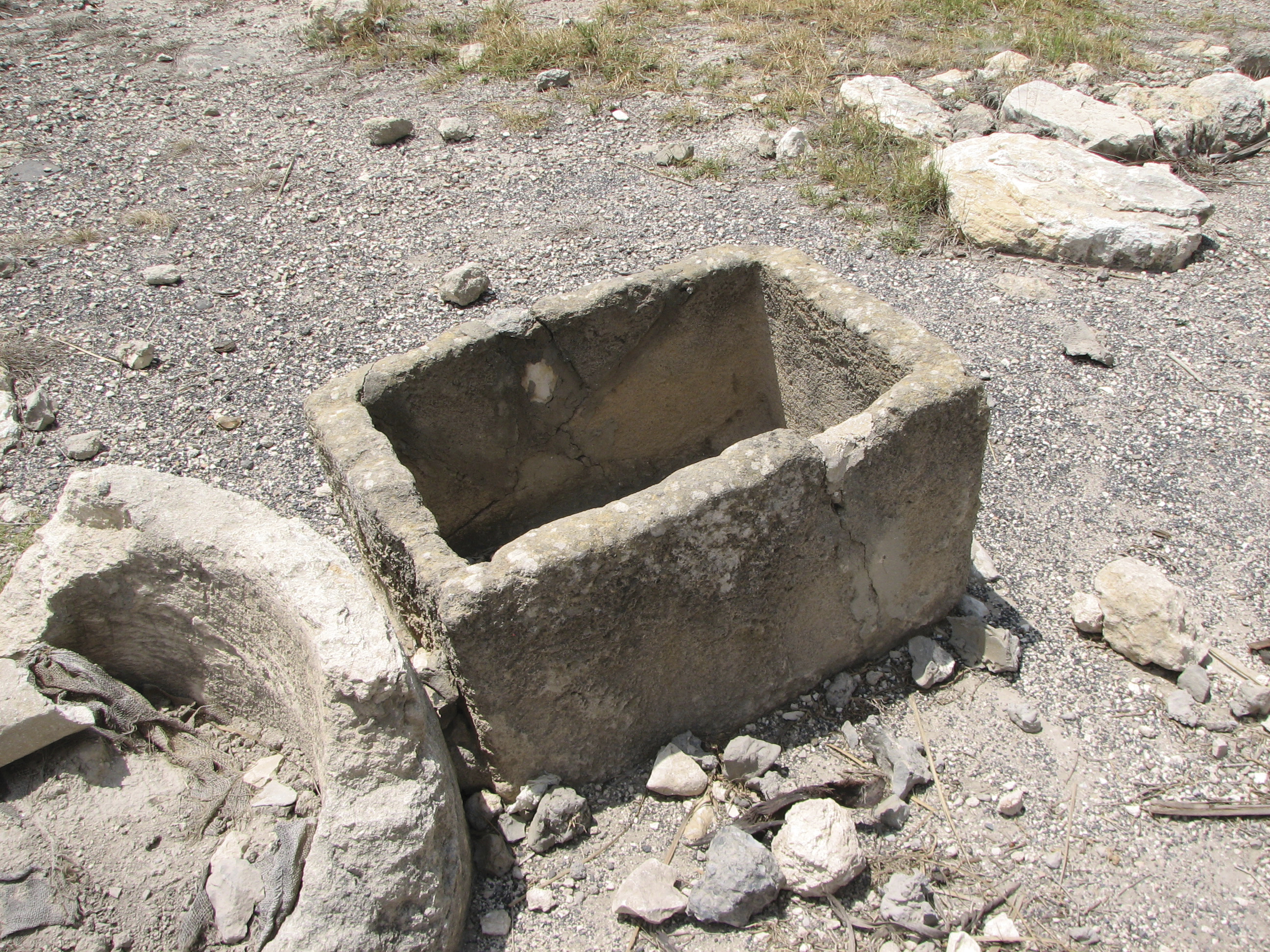 The remains of a square stone crib carved out to be used for feeding animals.