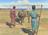 brothers walking in desert