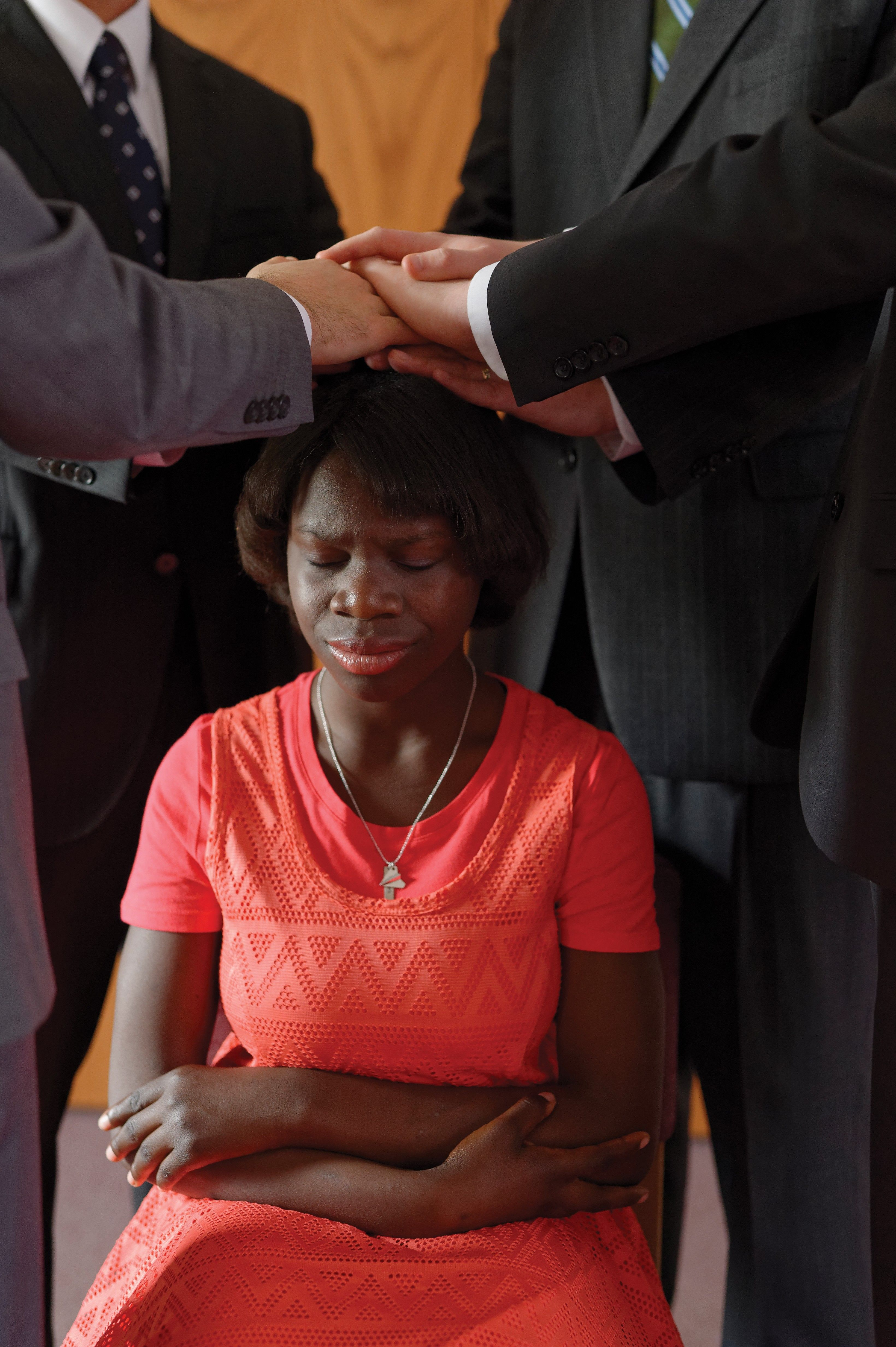 A woman being confirmed and receiving the gift of the Holy Ghost.