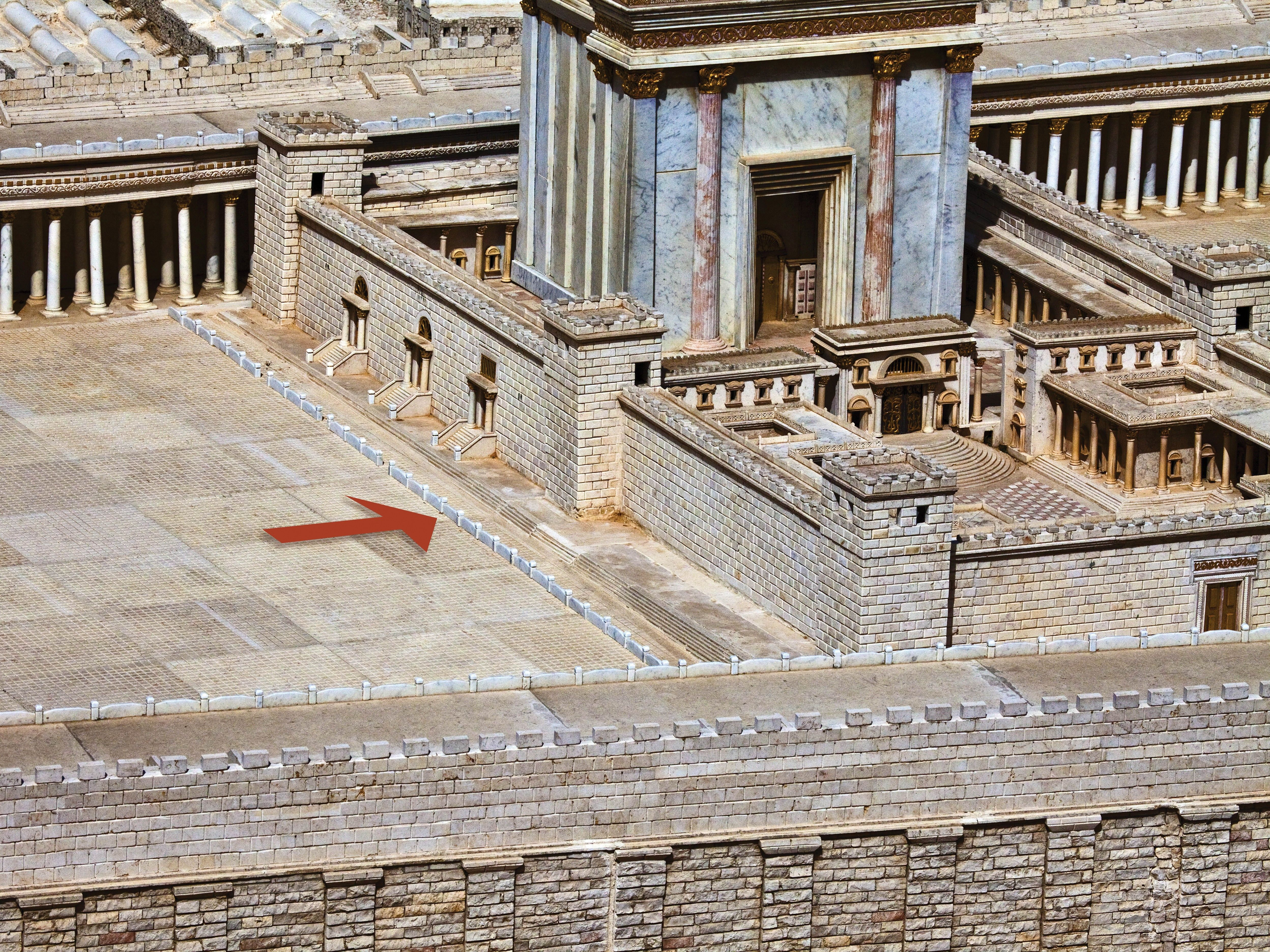 A model of first-century Jerusalem, with the wall of partition around the temple indicated by an arrow.