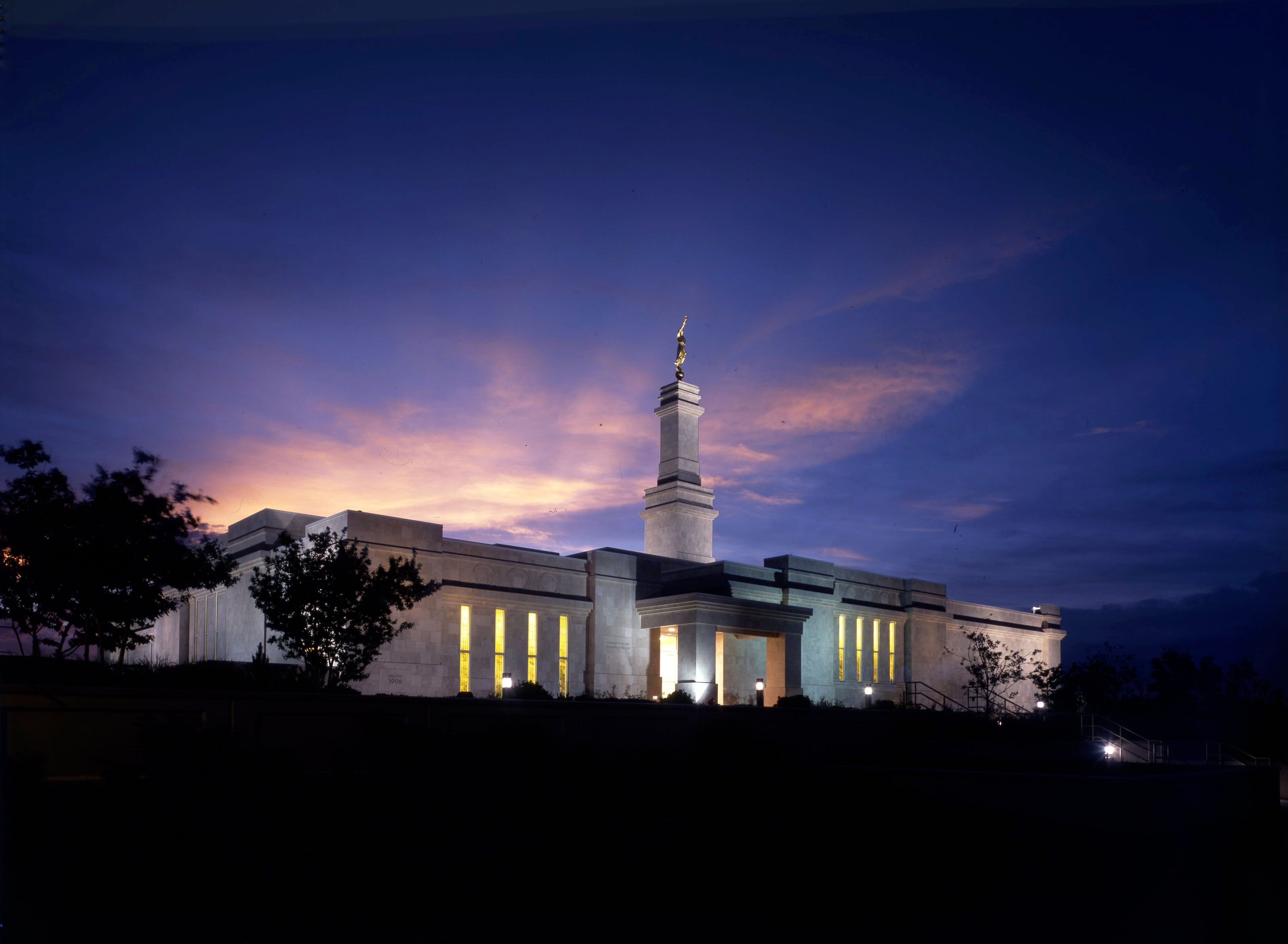 The Monticello Utah Temple in the evening, including scenery.