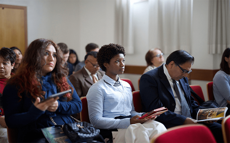 A congregation in a church learn about Jesus Christ