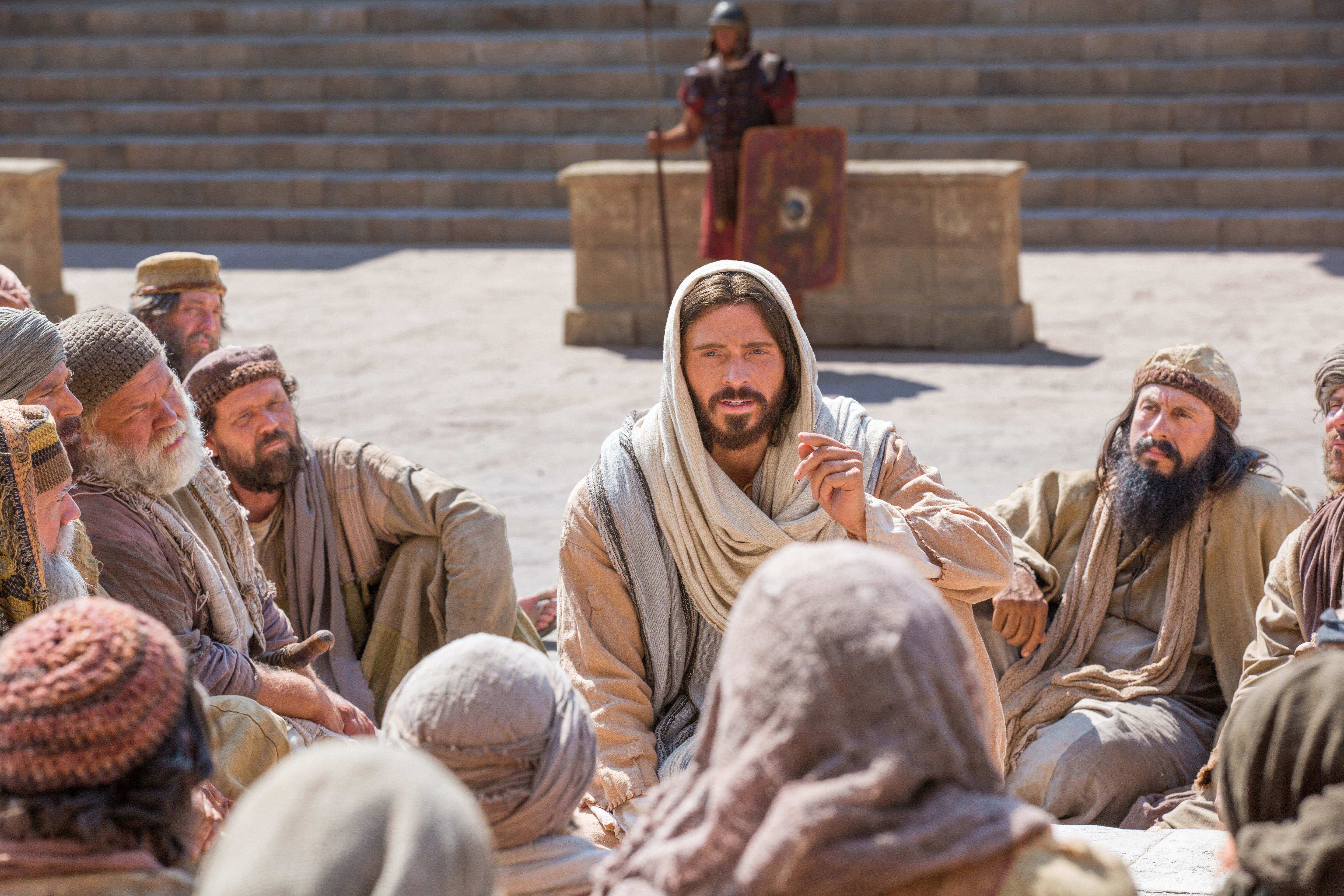 Christ tells a group of people that He is the Good Shepherd.
