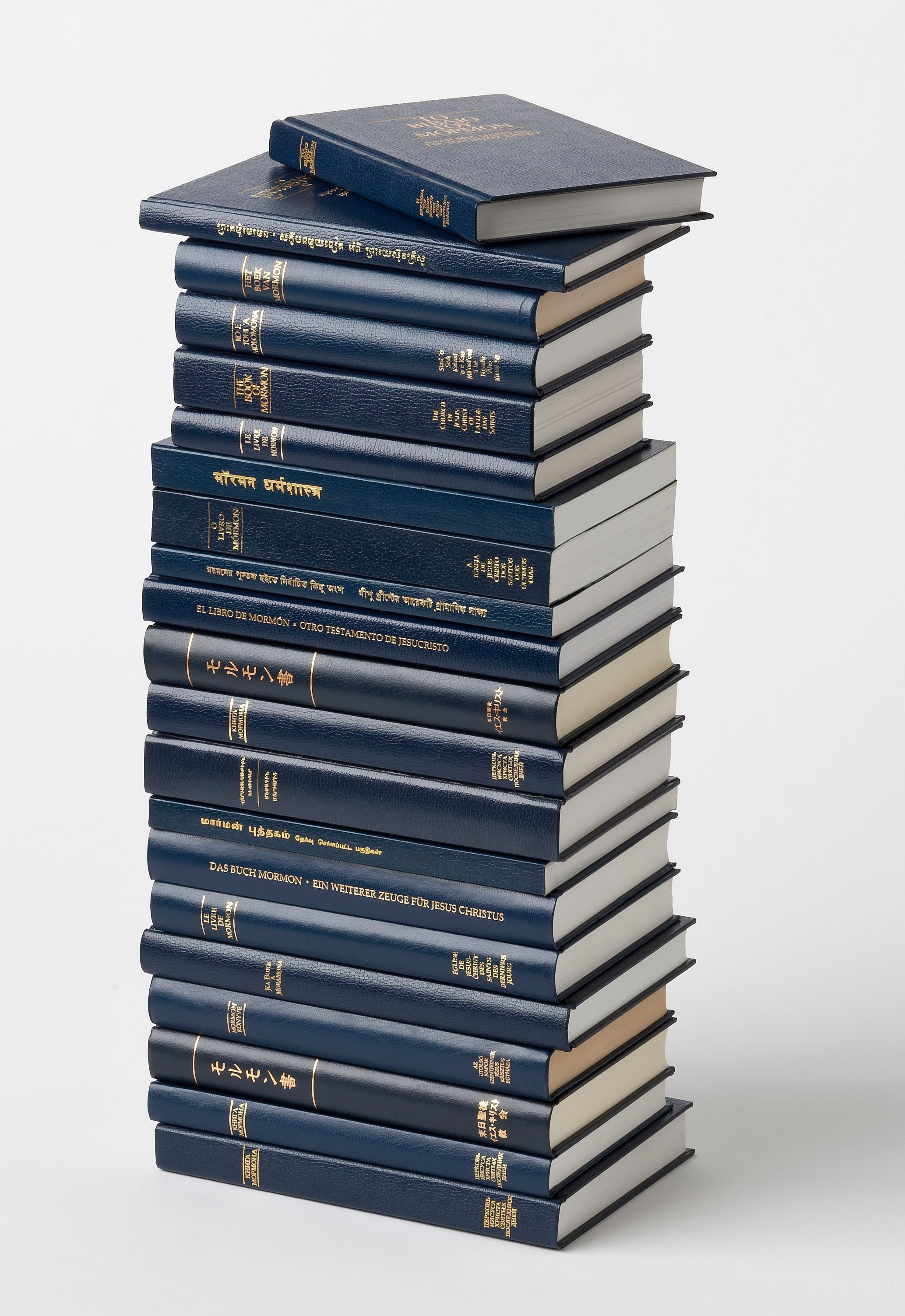 A stack of 21 copies of the Book of Mormon.