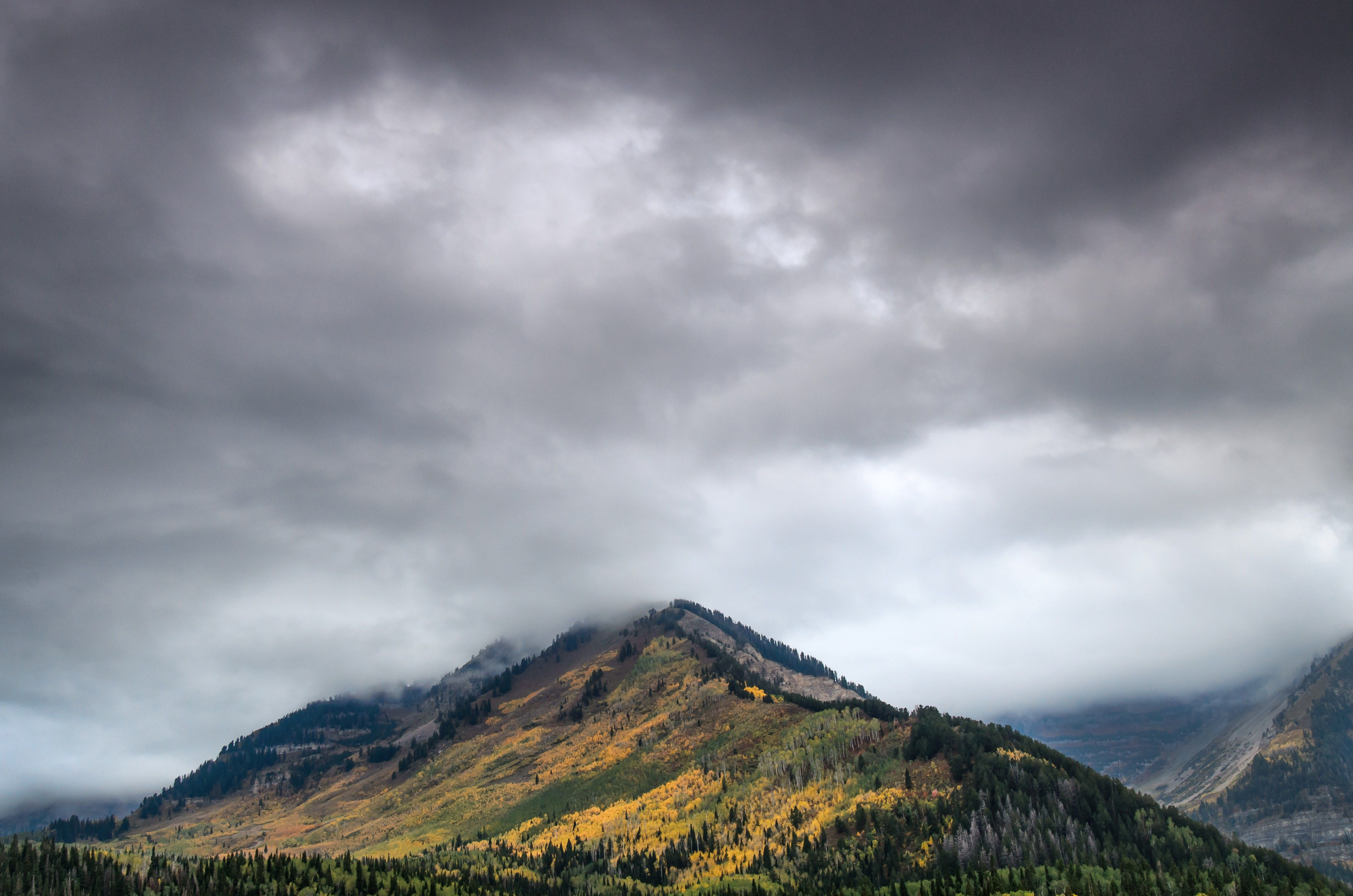 Alpine Loop in autumn with storm clouds.
