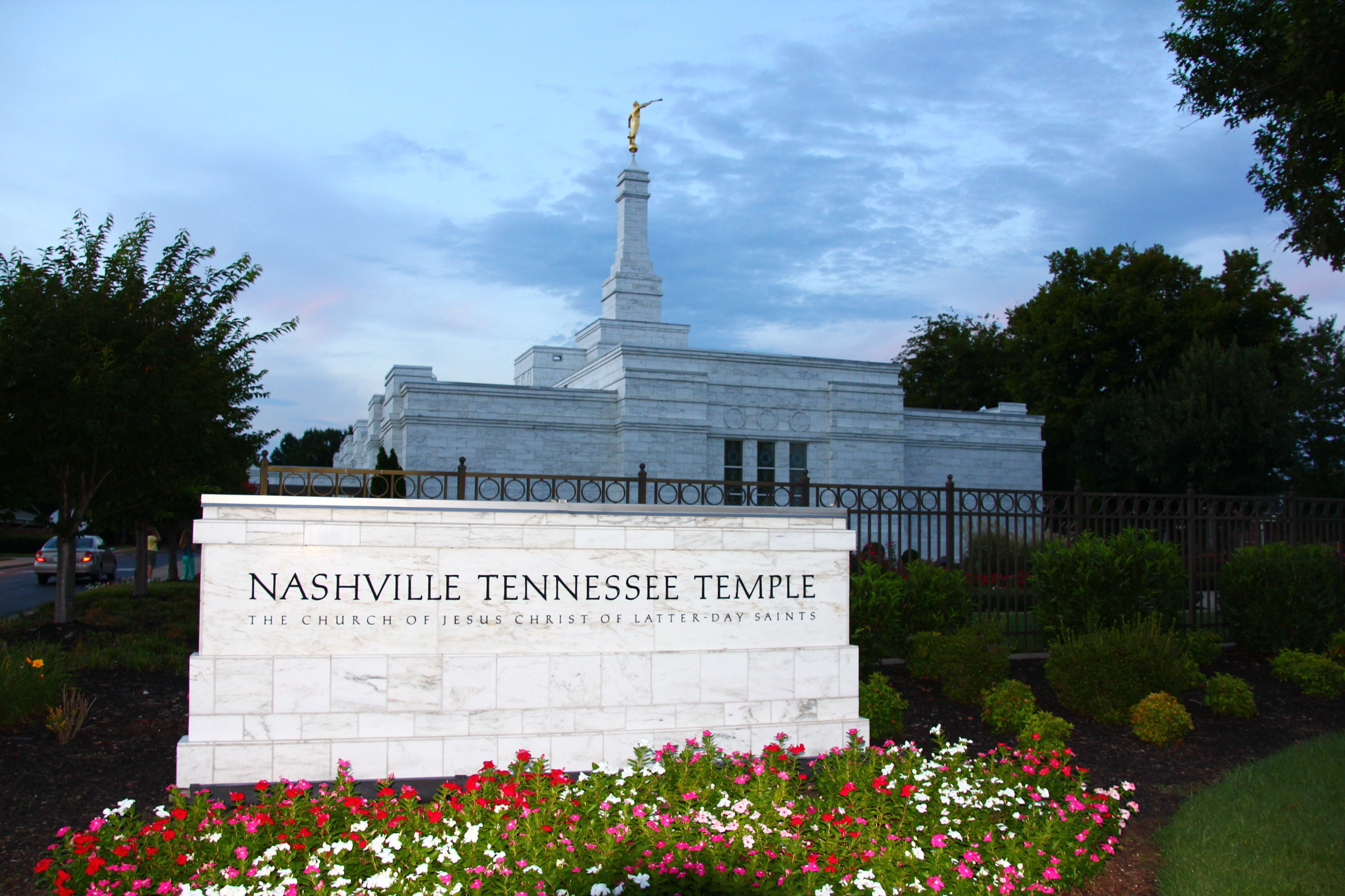The Nashville Tennessee Temple name sign, including scenery and the exterior of the temple.