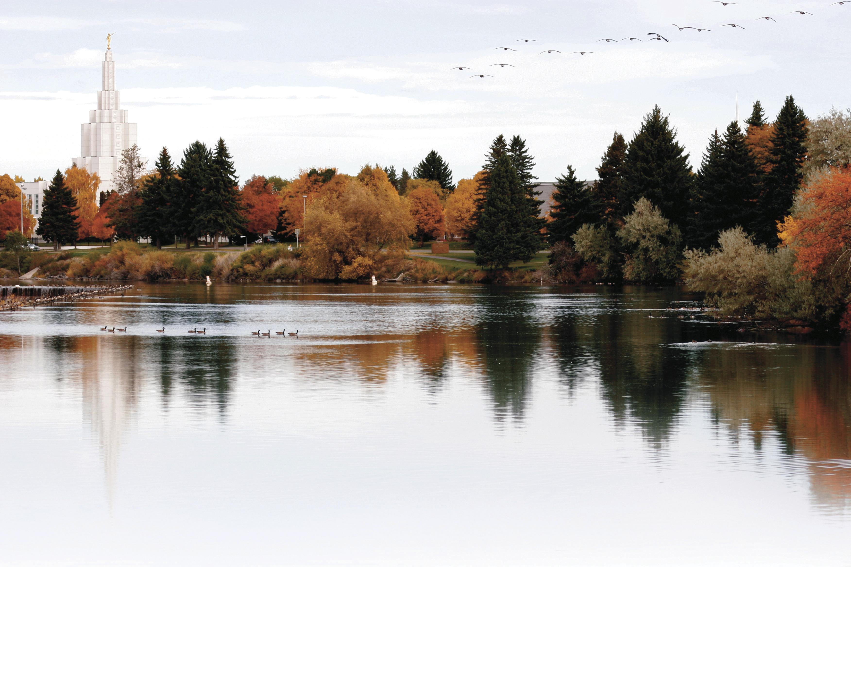 The Idaho Falls Idaho Temple in the fall, including lake and scenery.