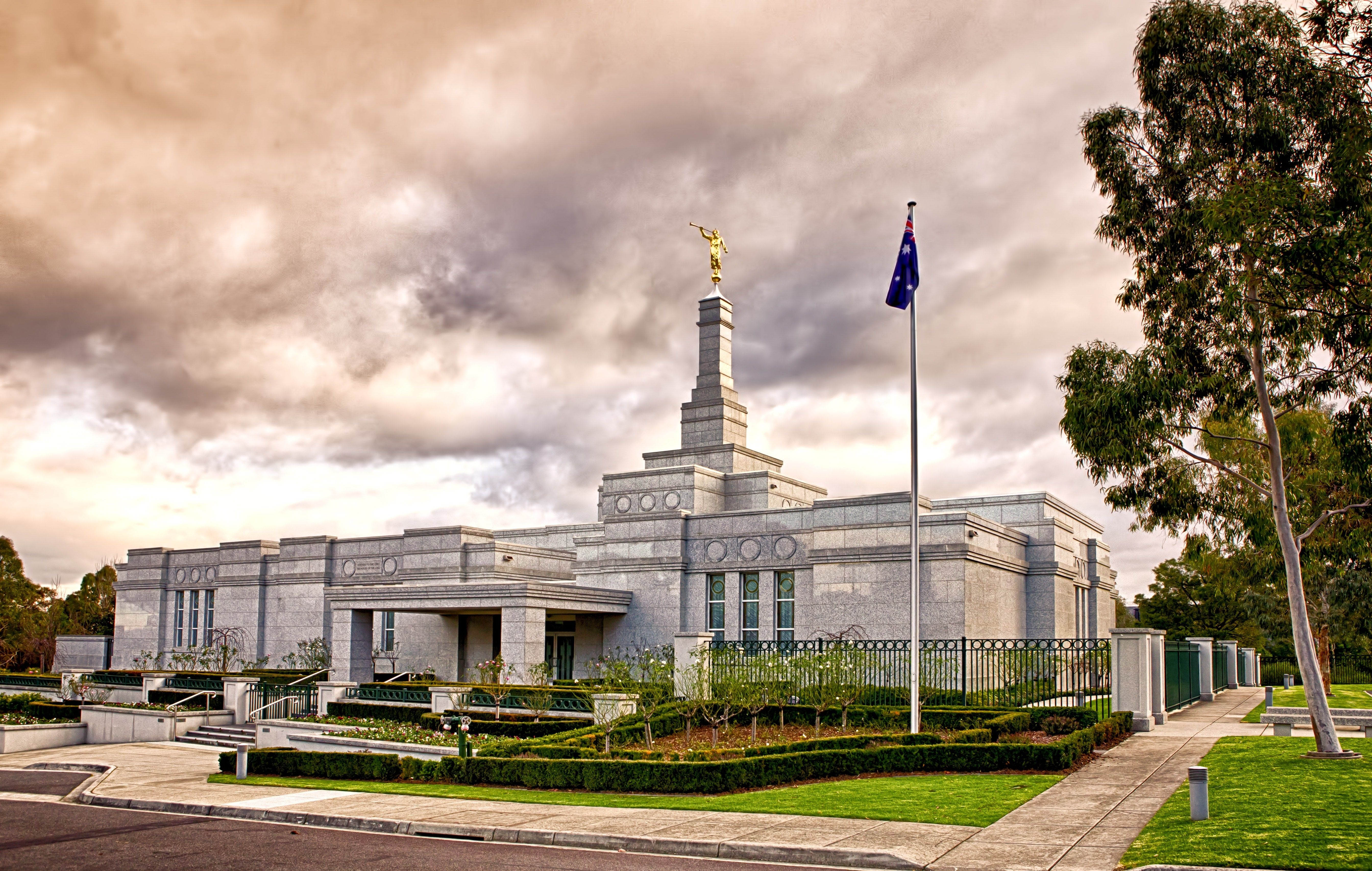 The Melbourne Australia Temple, including the entrance and scenery.