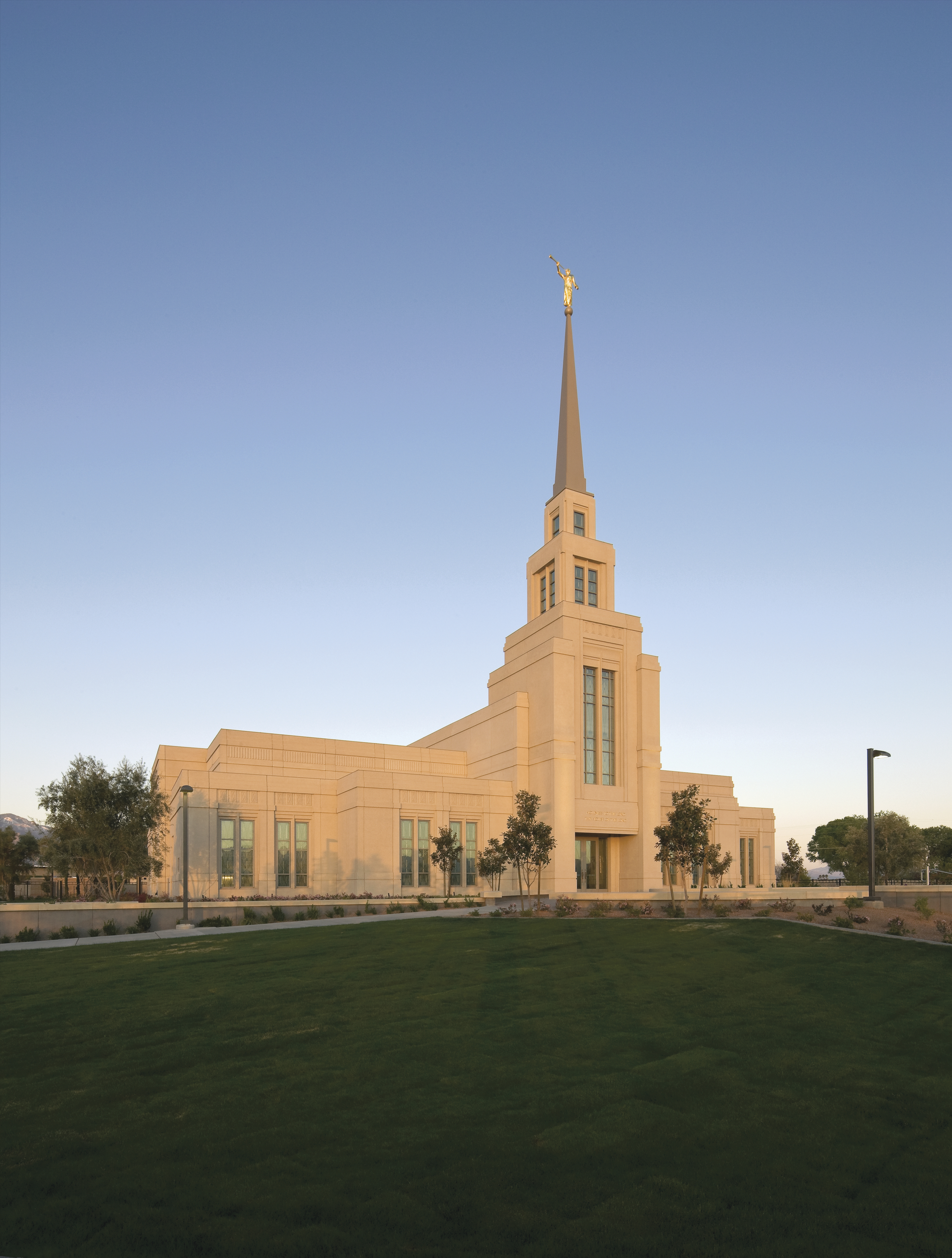 The Gila Valley Arizona Temple at sunset, including the grounds.