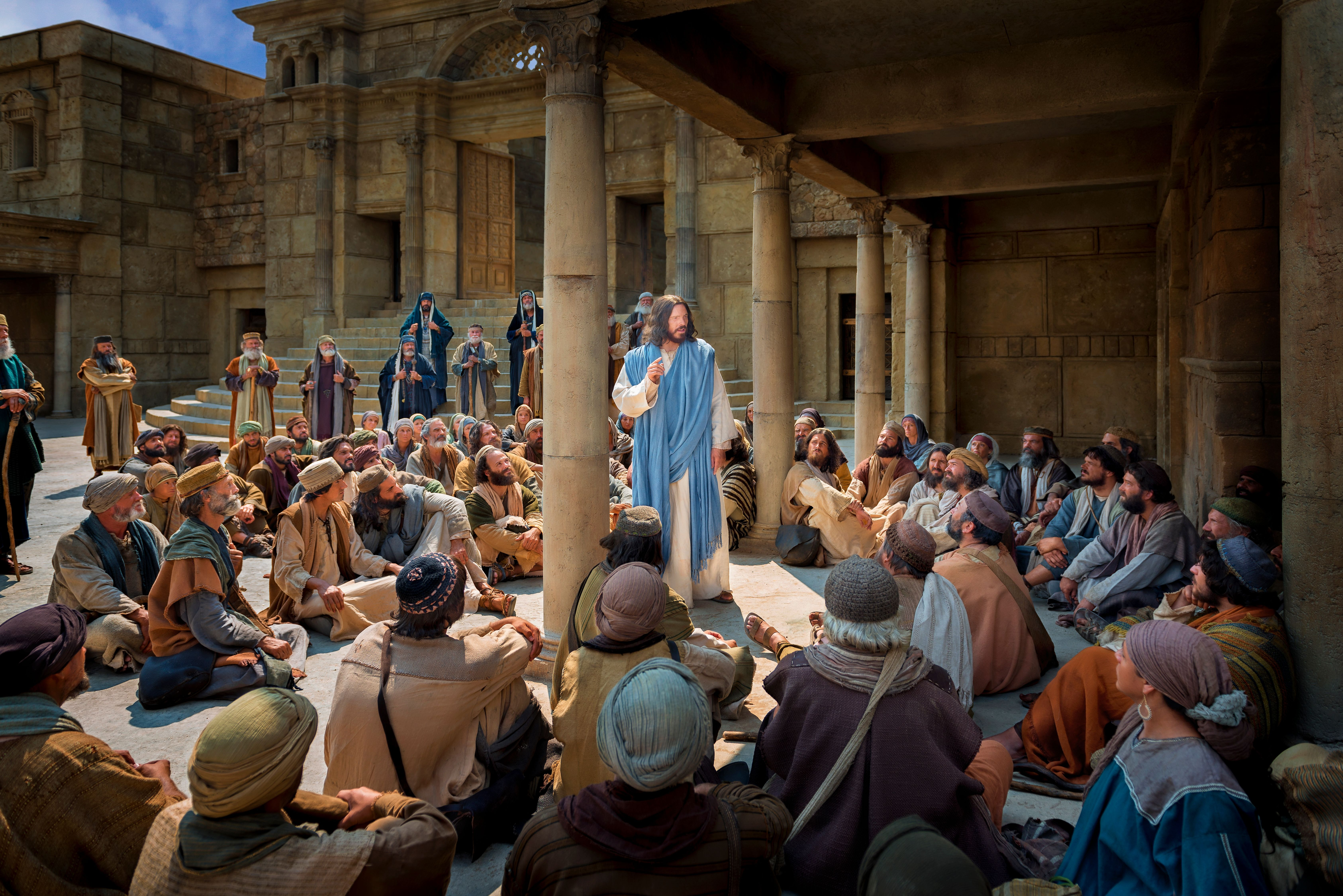 Christ teaches a crowd of people.