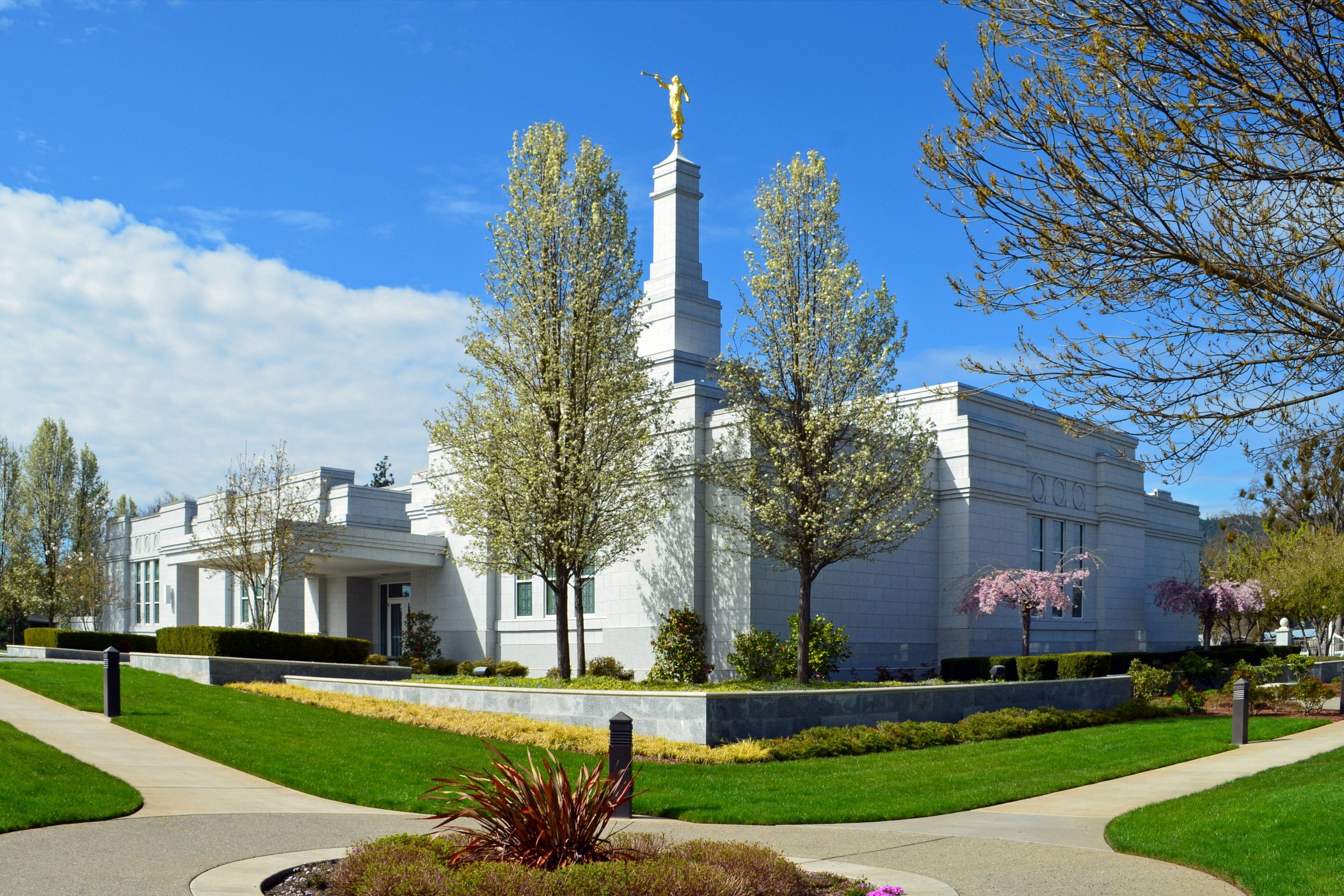 The Medford Oregon Temple side view, including scenery and entrance.