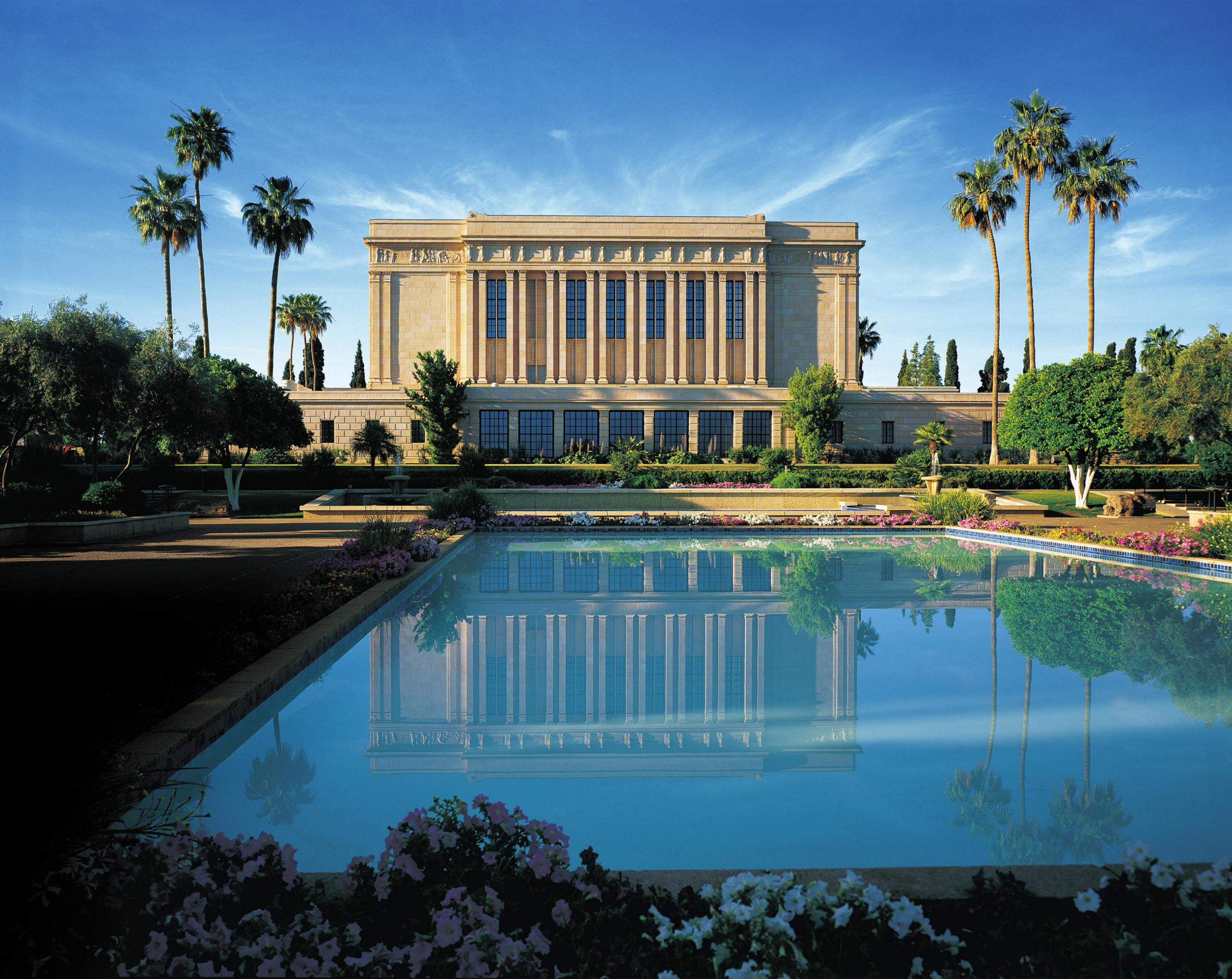 The Mesa Arizona Temple and its reflecting pool on a sunny day.