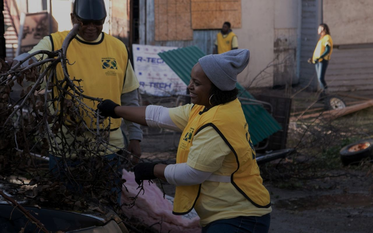 A woman preforms community service after a natural disaster