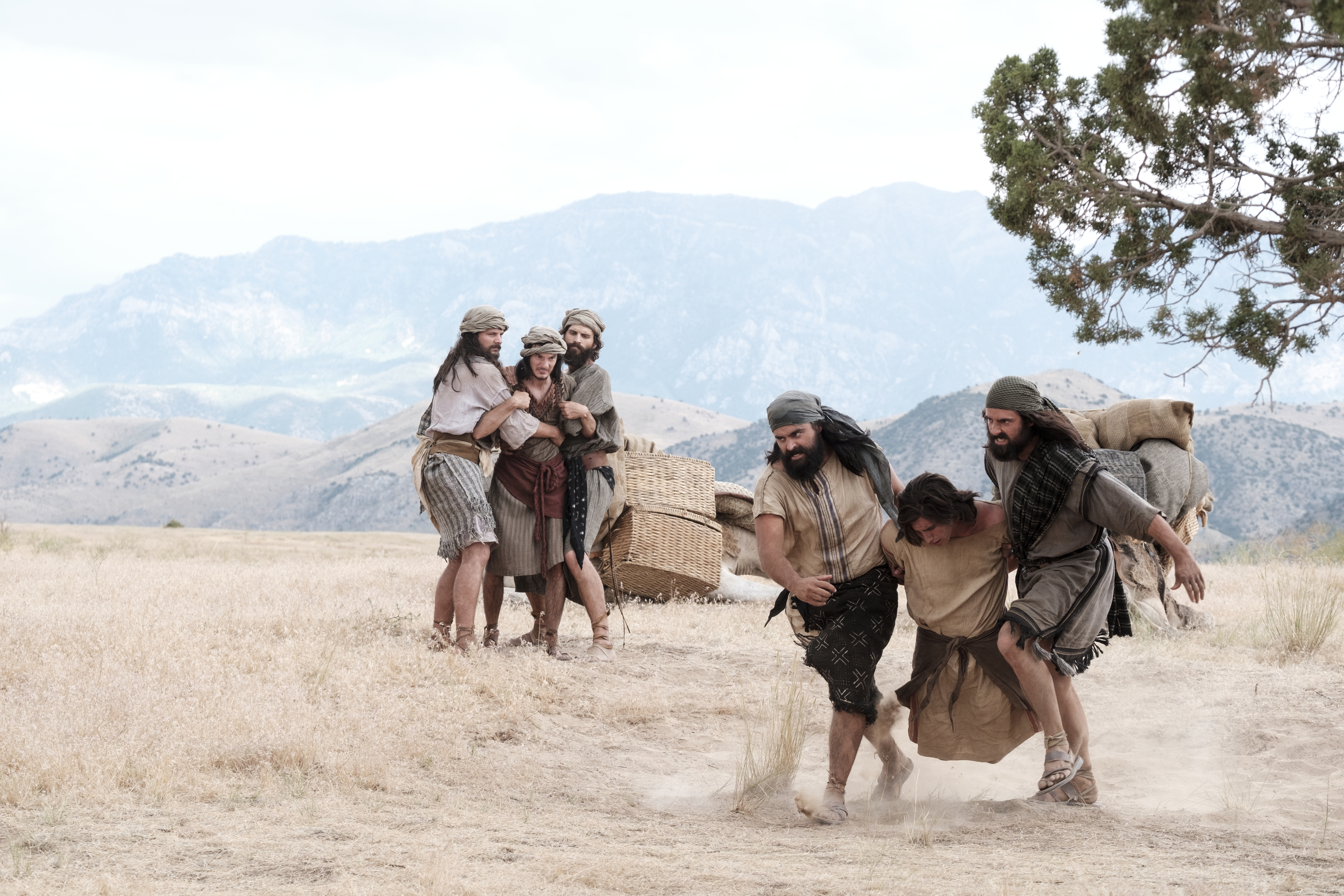 Laman and Lemuel bind and carry Nephi.