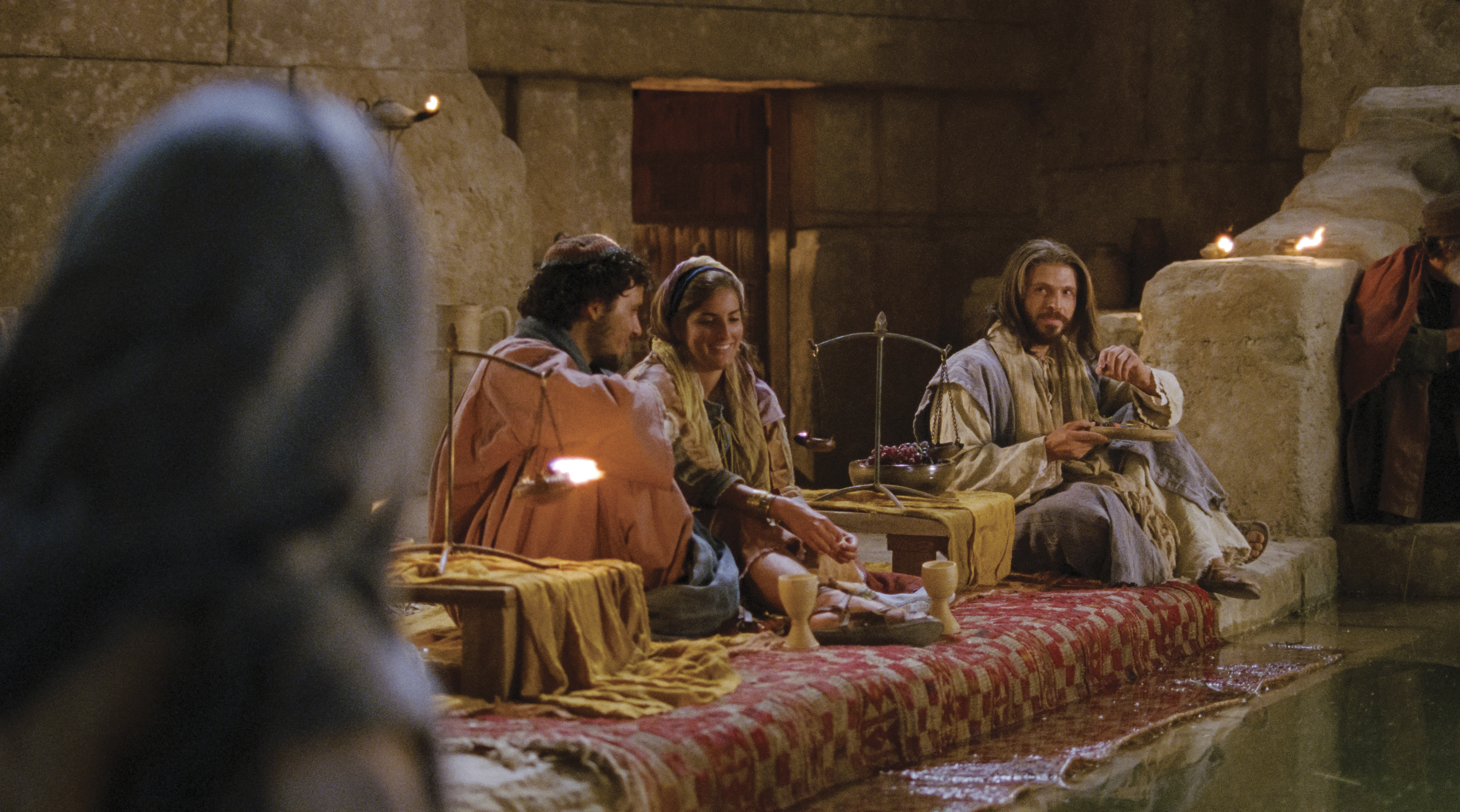 Jesus sits at the wedding feast.