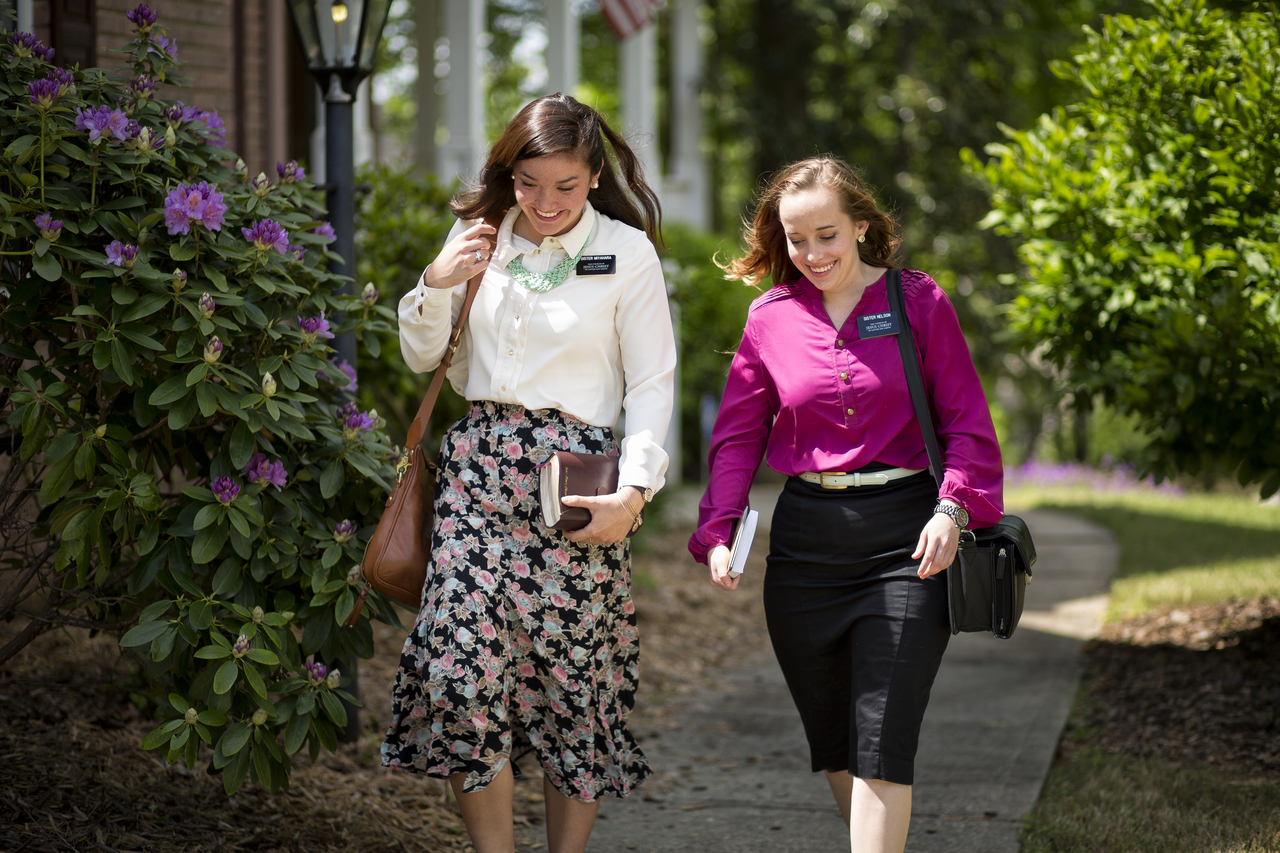 Two Latter-day Saint missionaries walking down the street