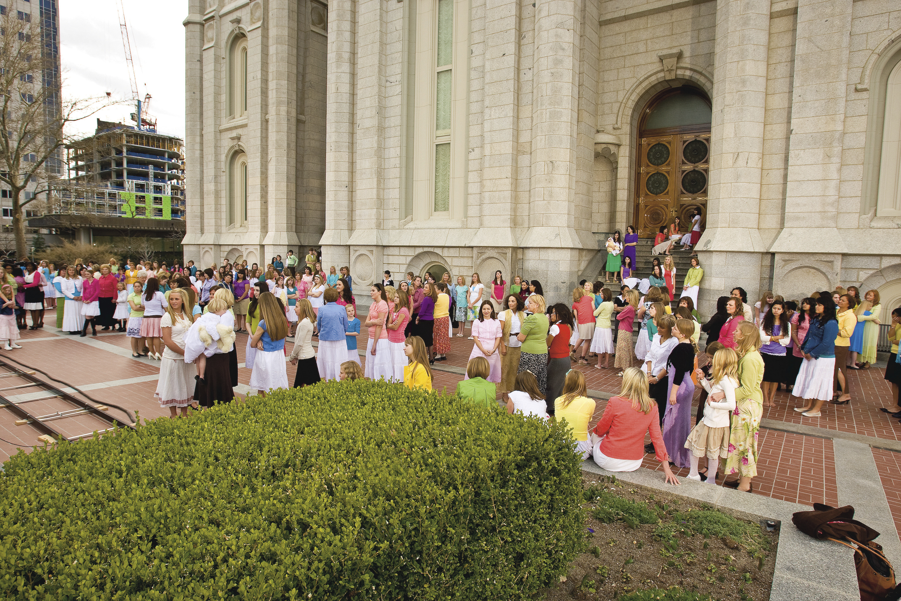 Groups of young women and their leaders gather outside the Salt Lake Temple.