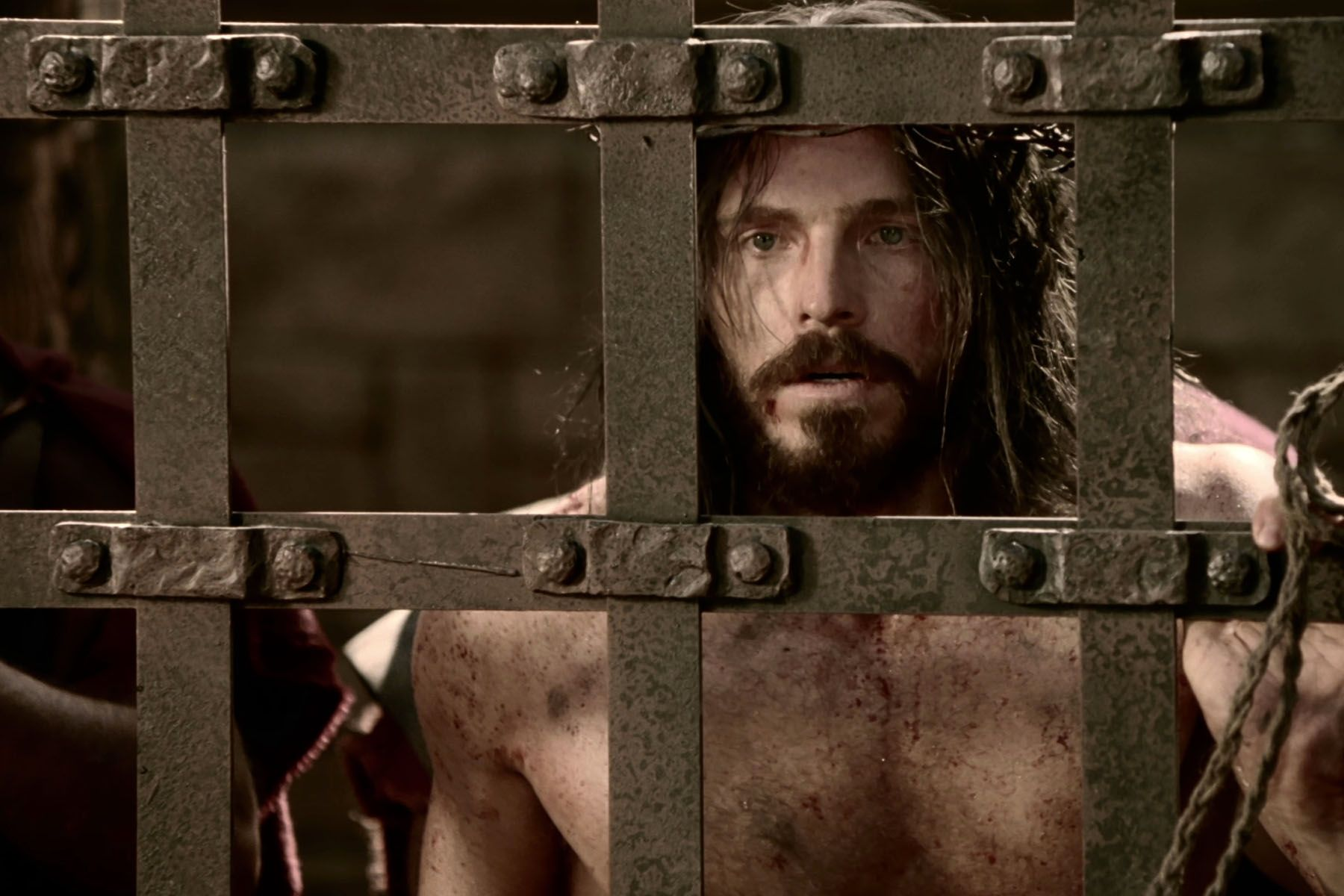 Jesus is scourged by soldiers while in prison.