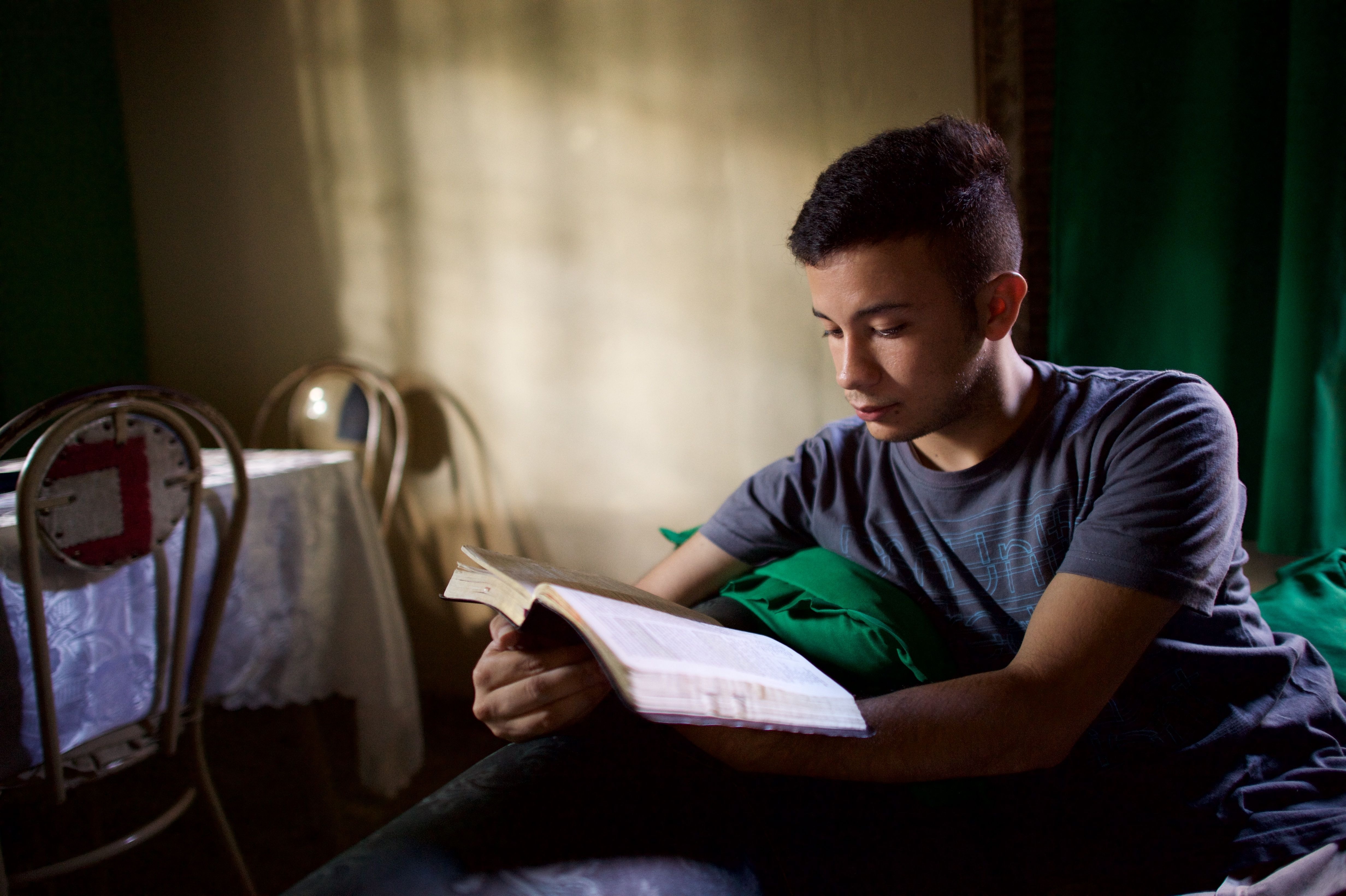 A young man studying scriptures.