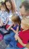 Family watching an iPad