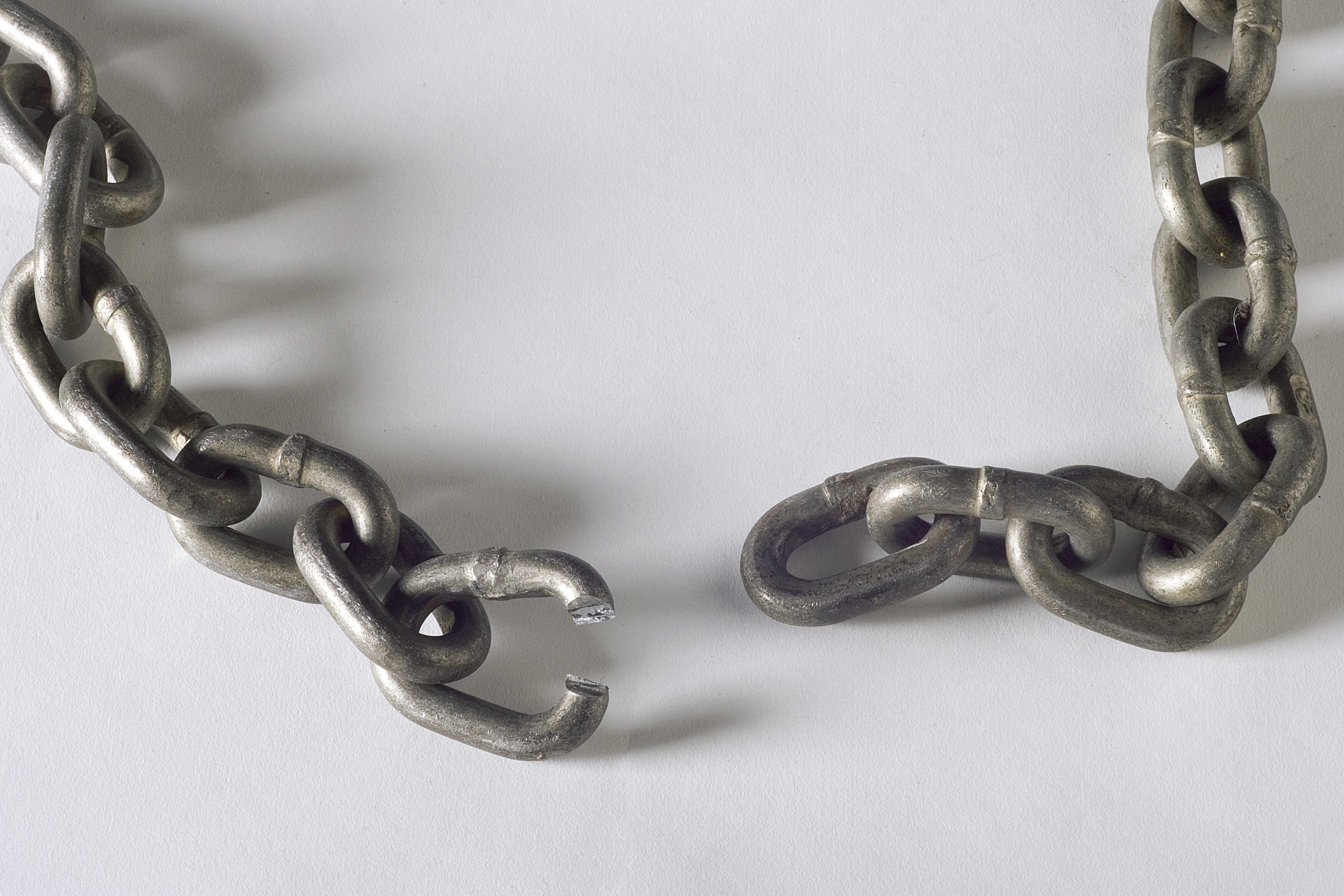 A heavy chain shown with a broken link.