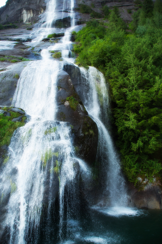 A waterfall runs into a pool in Alaska.