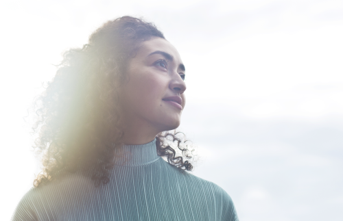 United Kingdom: Young woman looking into distance