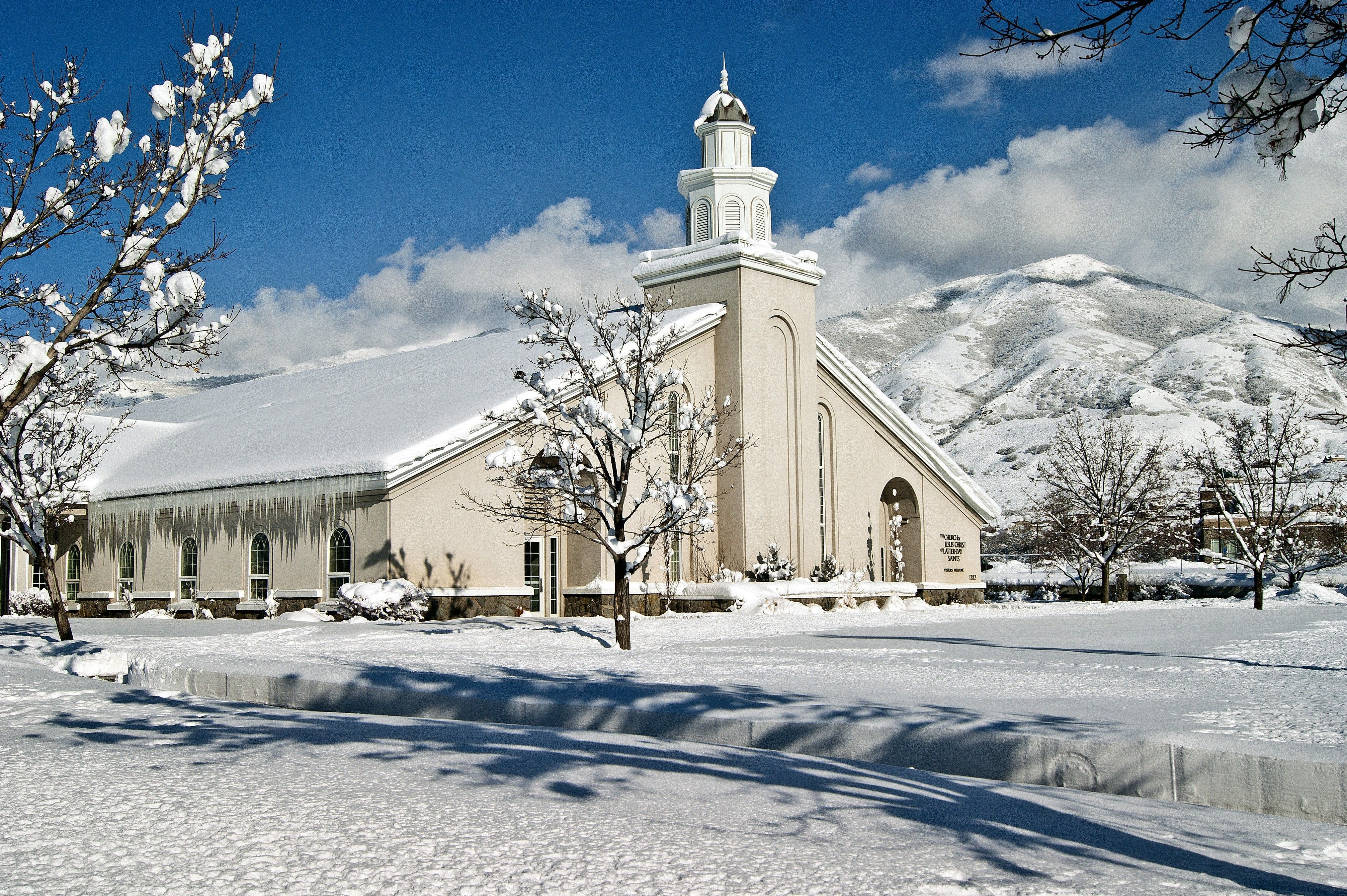 A snow-covered chapel and ground in Farmington, Utah.