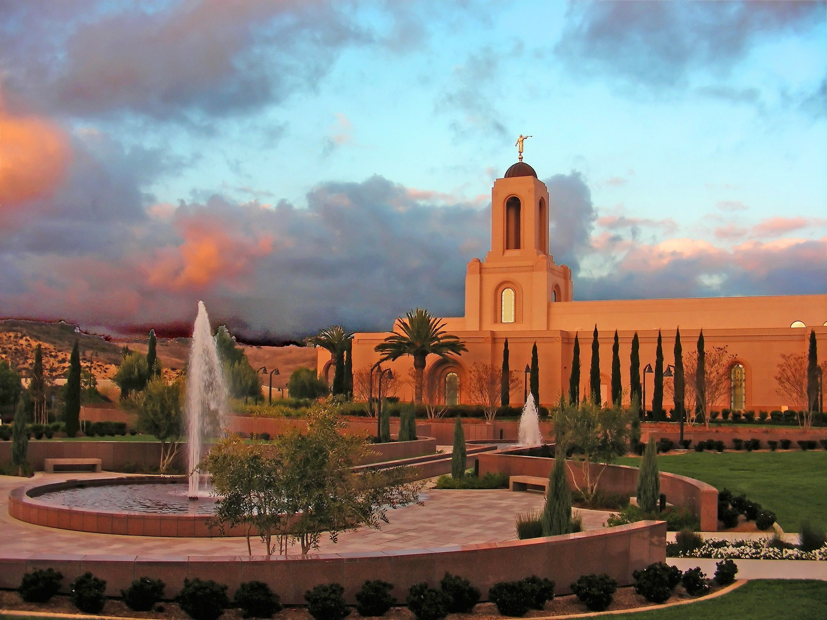 The Newport Beach California Temple at sunset, including fountains and scenery.