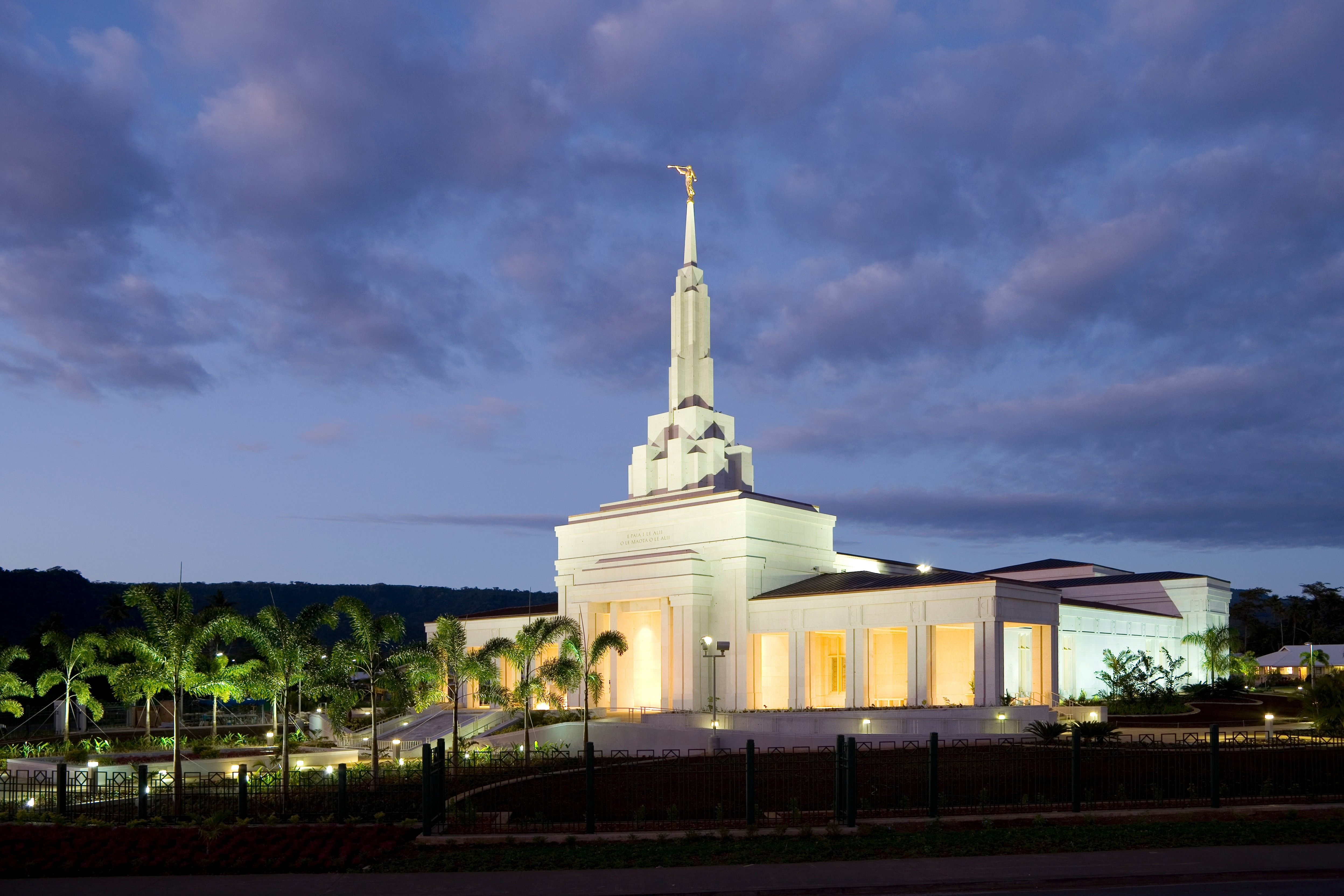 The Apia Samoa Temple lit up in the evening.