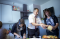 sister missionaries helping man prepare meal in kitchen