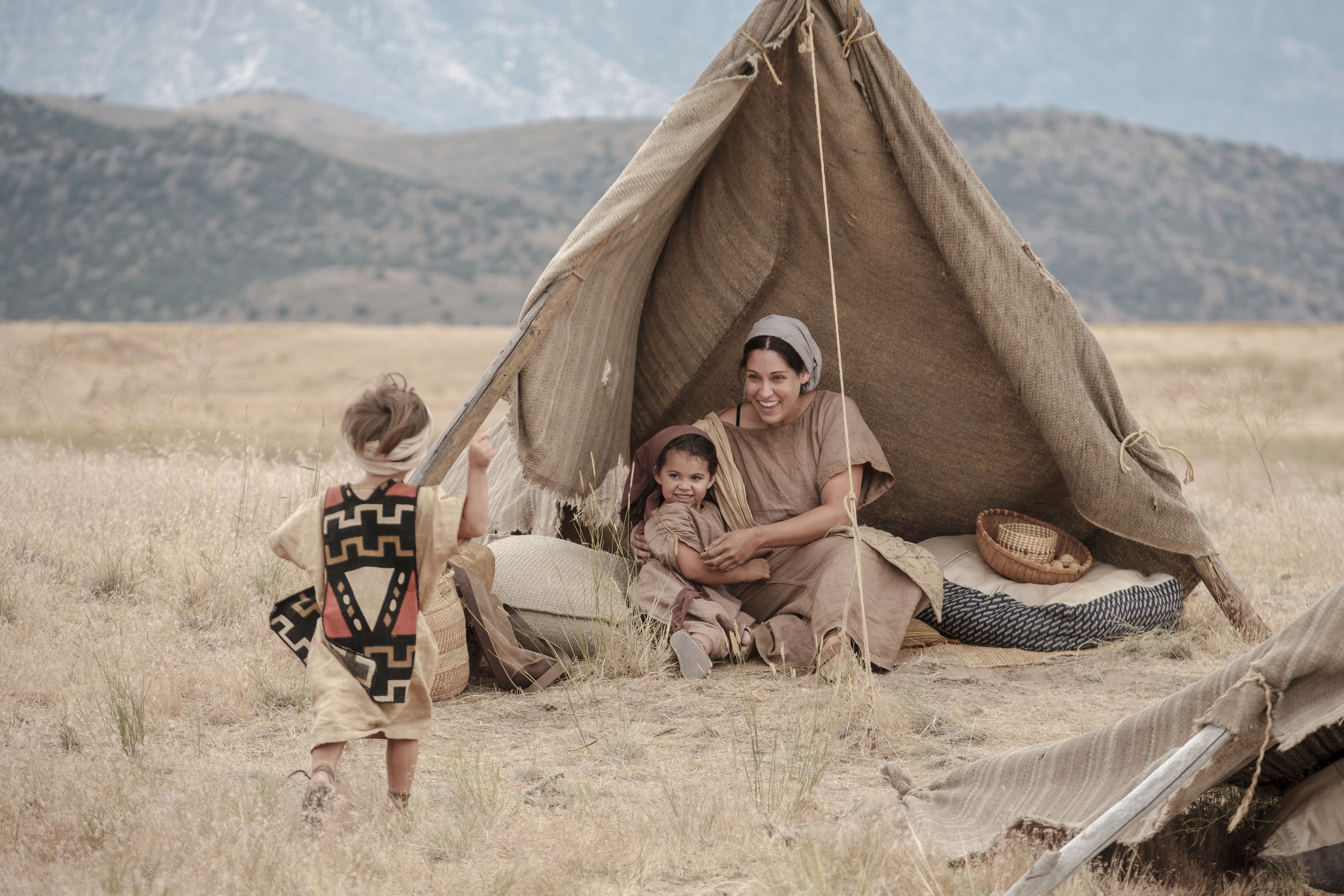 A daughter of Ishmael plays with children in the wilderness.