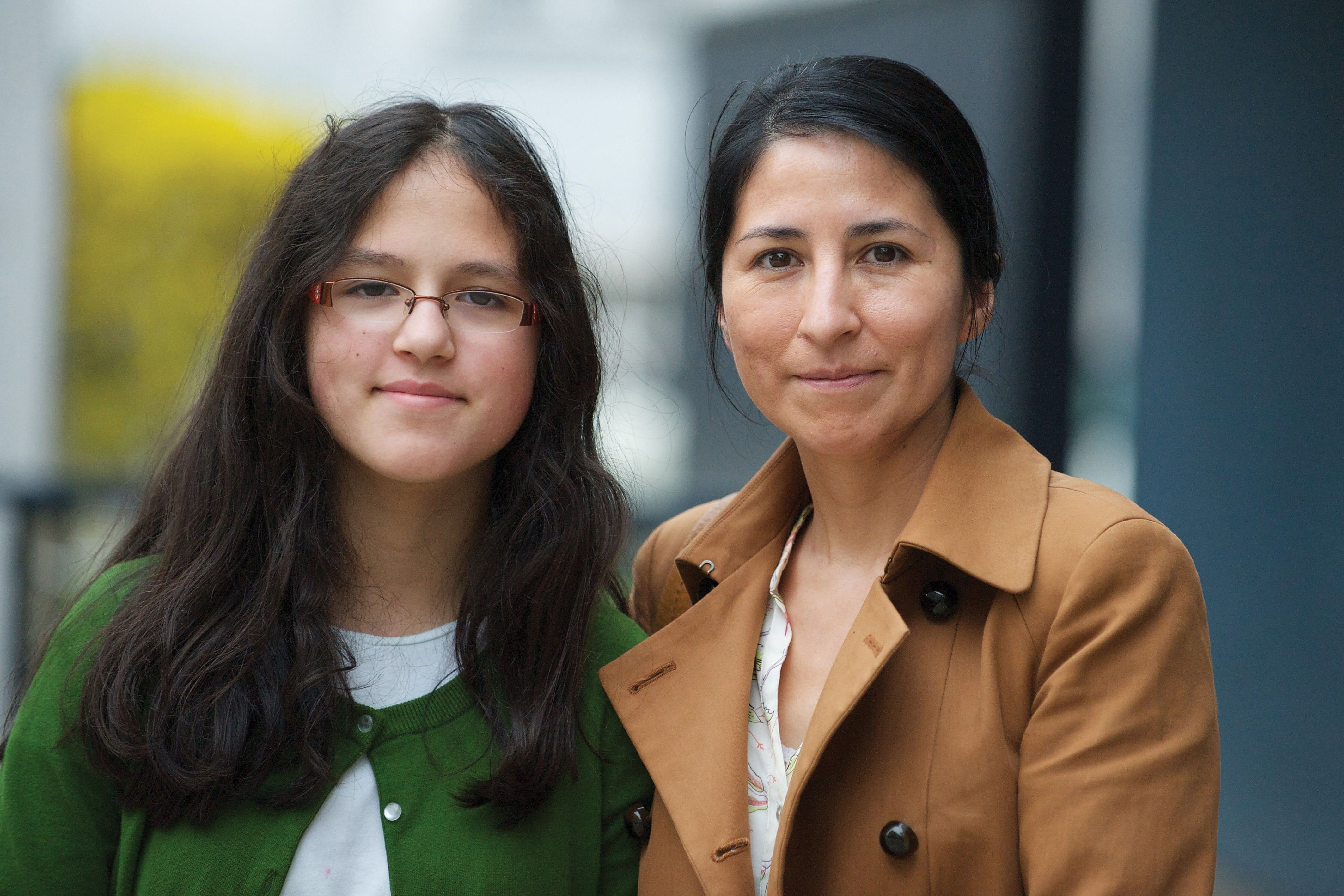 A mother and daughter attending the broadcast of the general women's session of general conference in Vienna, Austria.