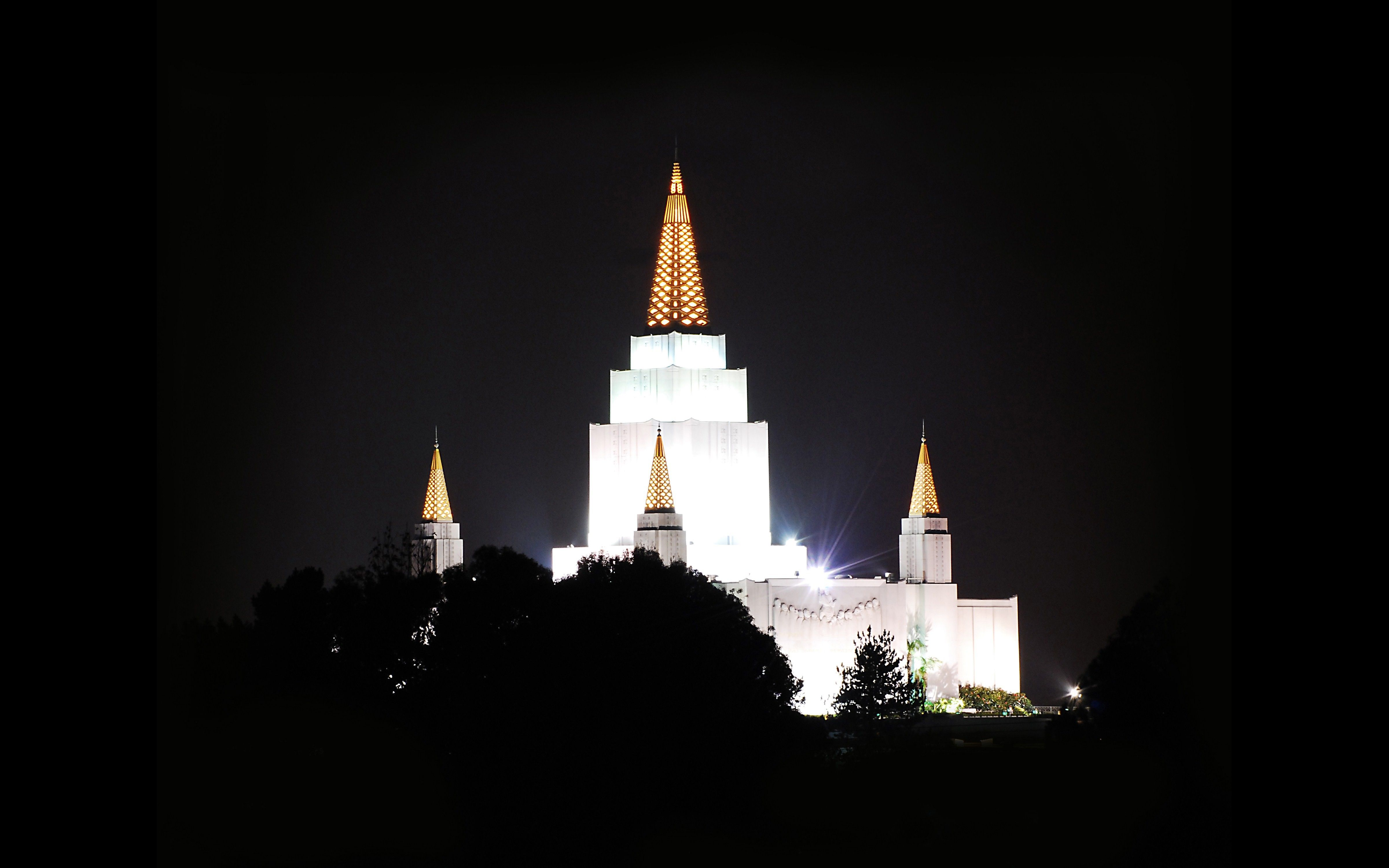 The Oakland California Temple in the evening, including scenery.