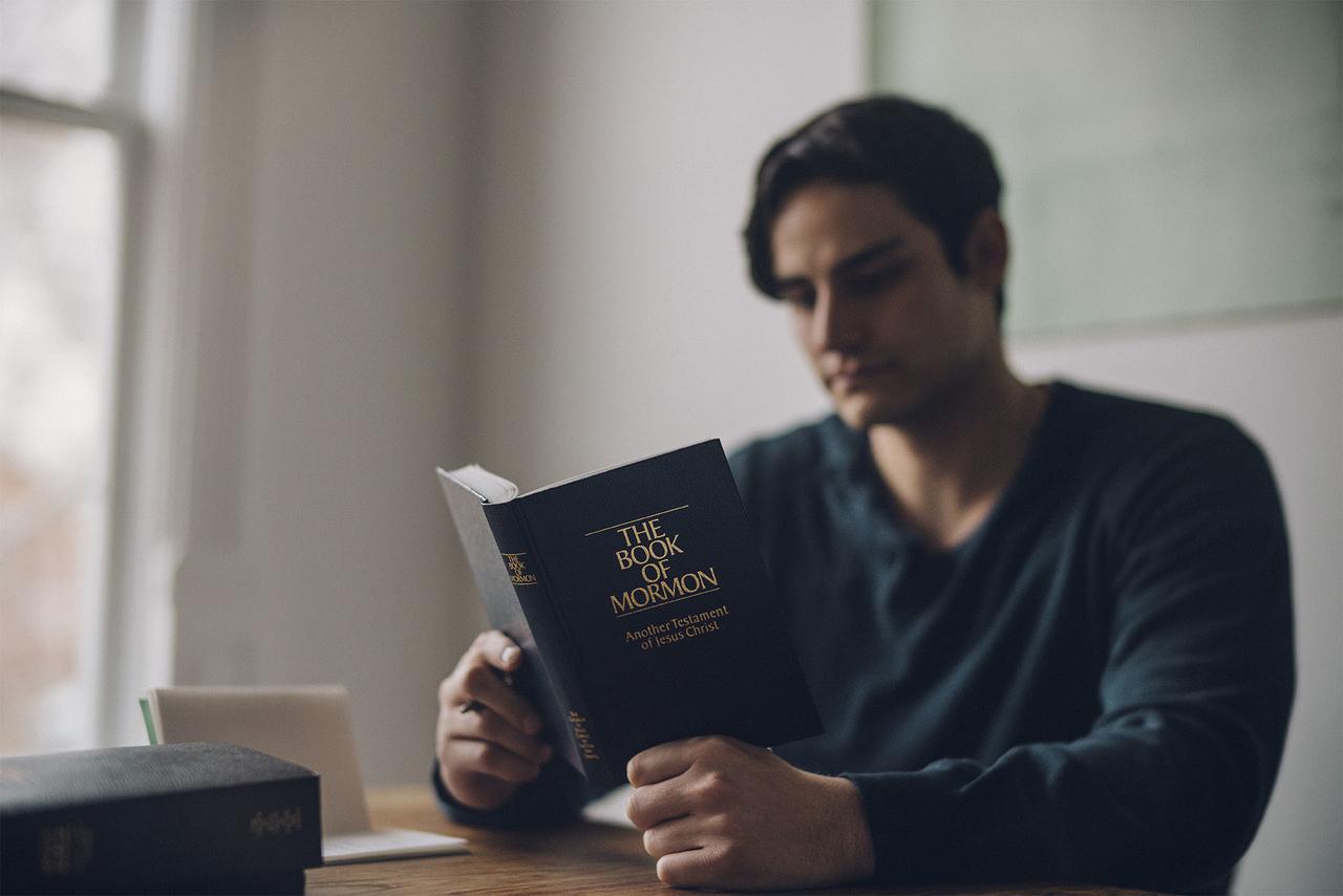 Man reading the Book of Mormon