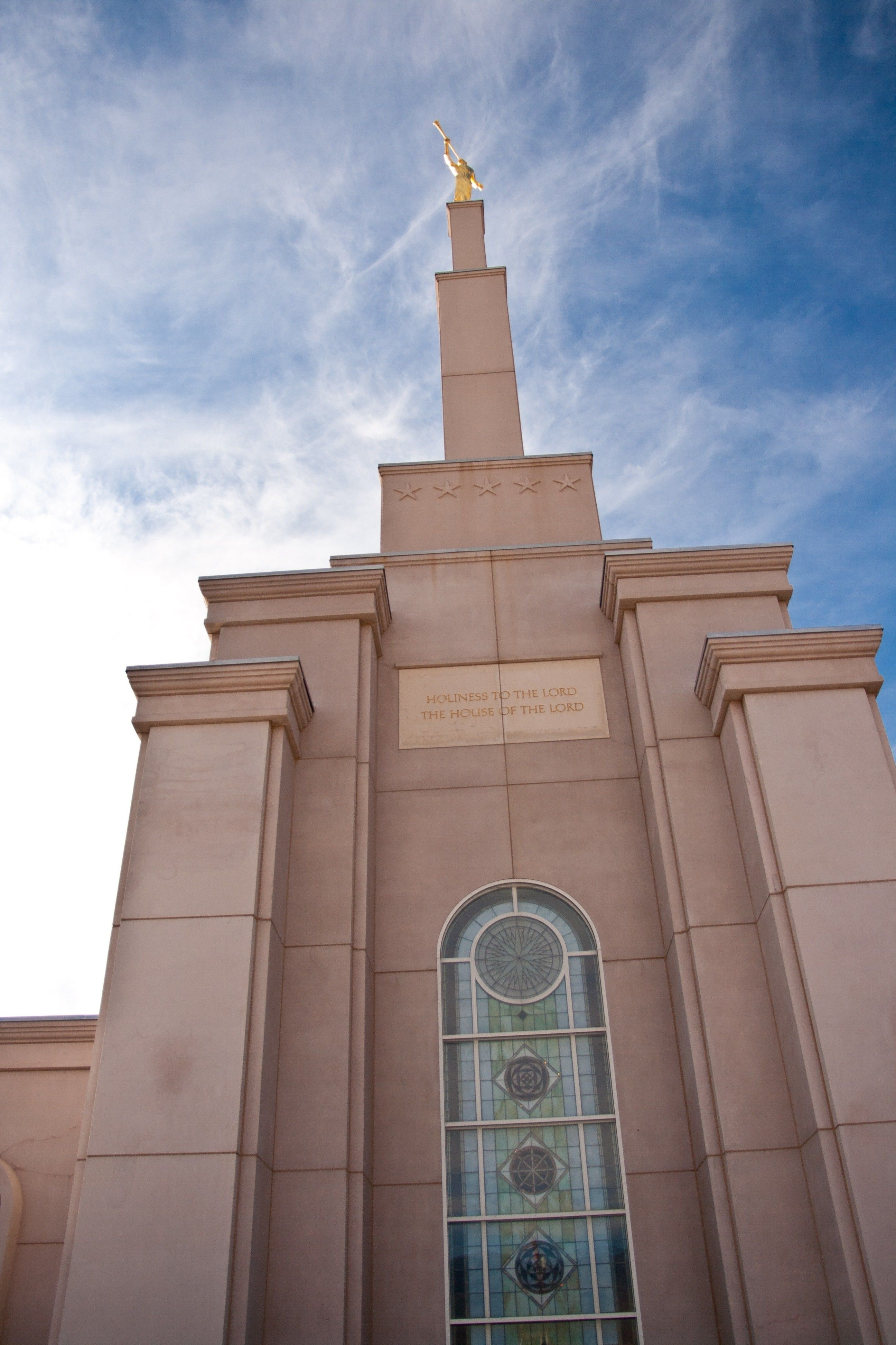 An upward view of the angel Moroni atop the spire of the Albuquerque New Mexico Temple.