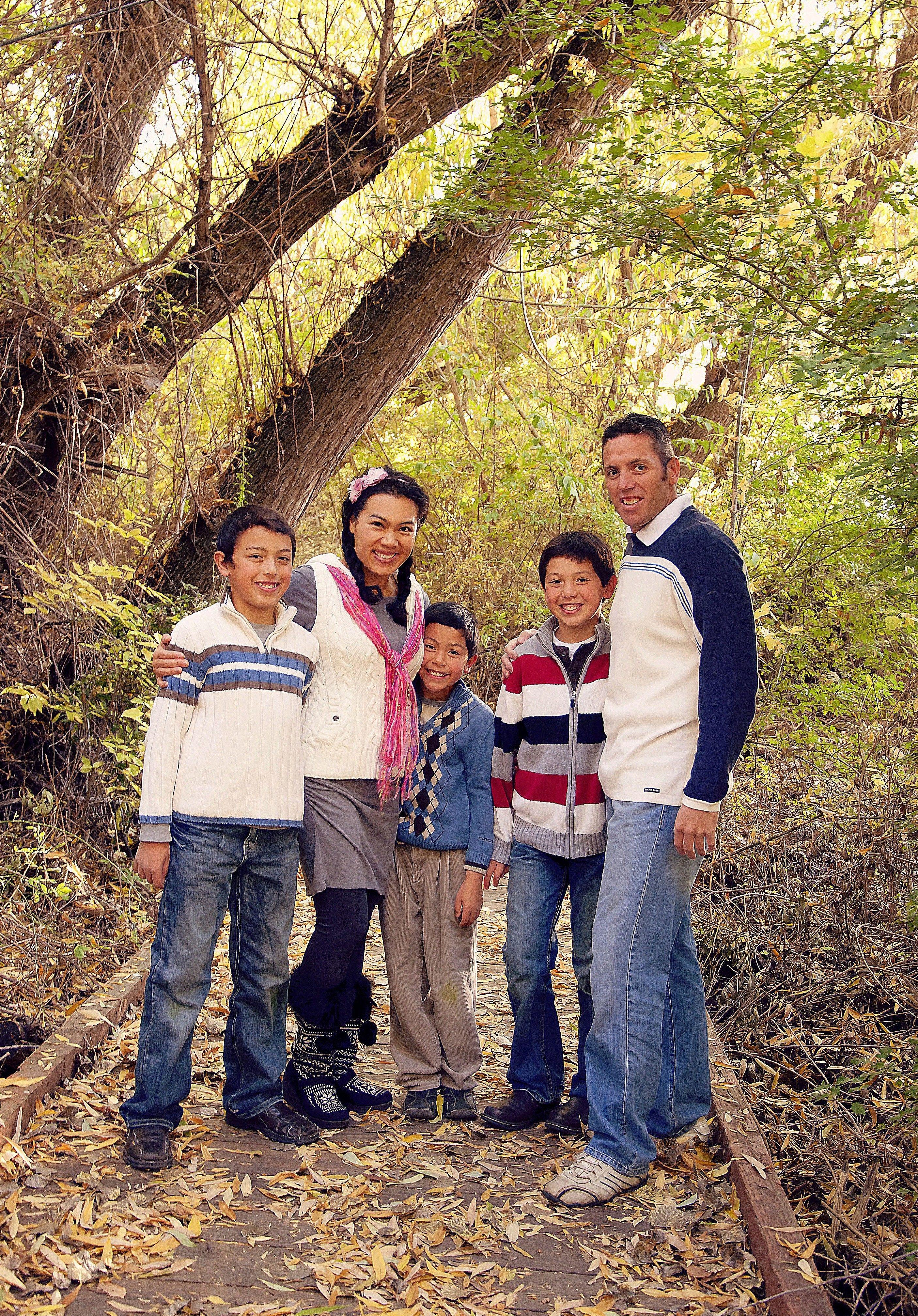 A family portrait taken in autumn.